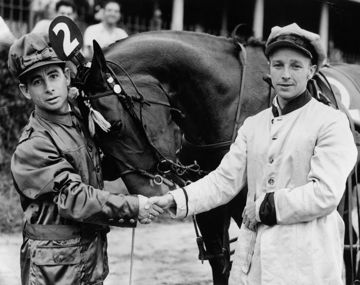 Johnny Longden and Wayne Wright shaking hands at an exhibition trotting race at Empire City in August 1943 (Acme Photo/Courtesy of Ken Grayson)