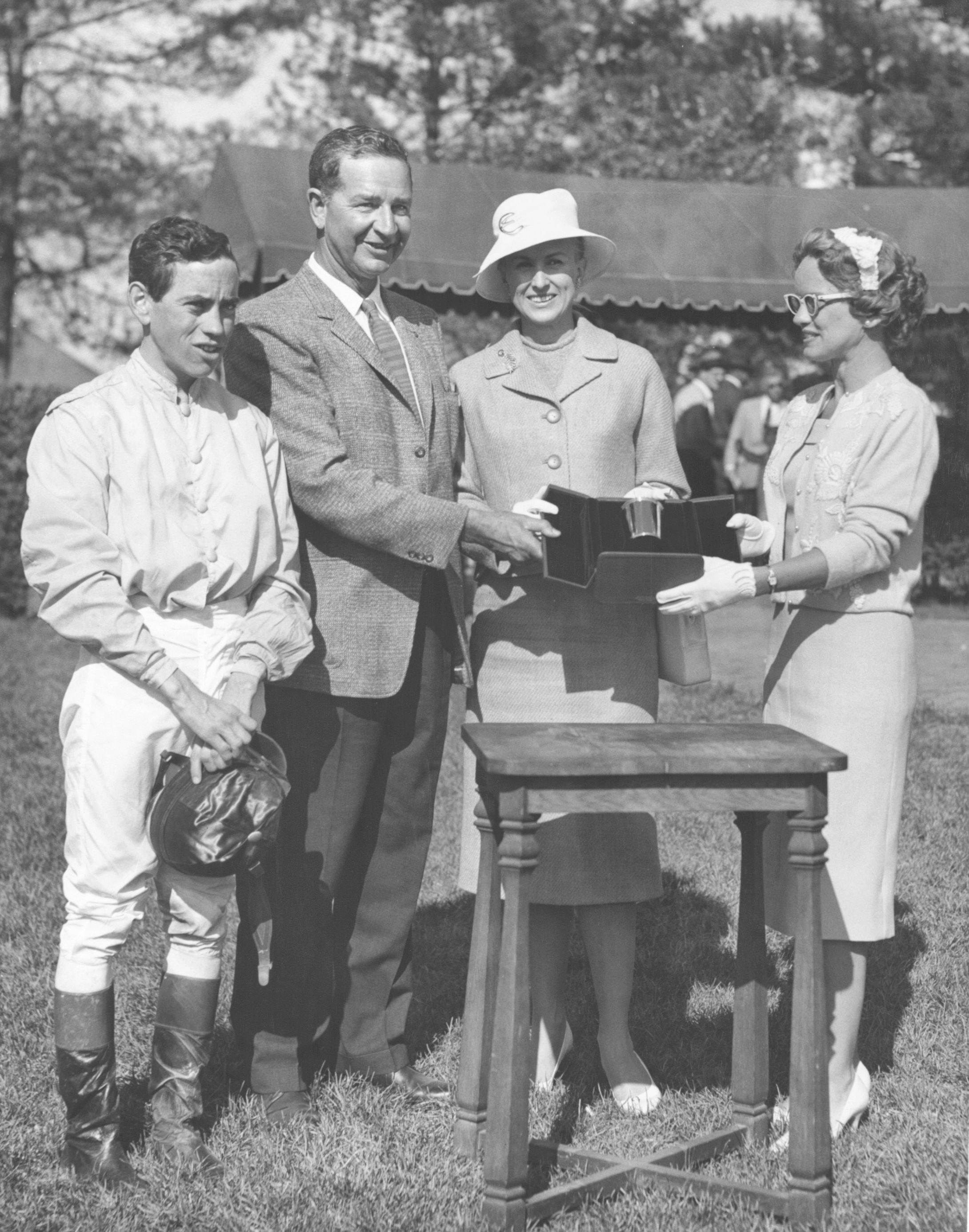 From left, John Rotz, C. V. Whitney, Marylou Whitney, and Mrs. Len Shouse III at Keeneland, 1960 Lafayette Stakes trophy presentation (Keeneland Library)