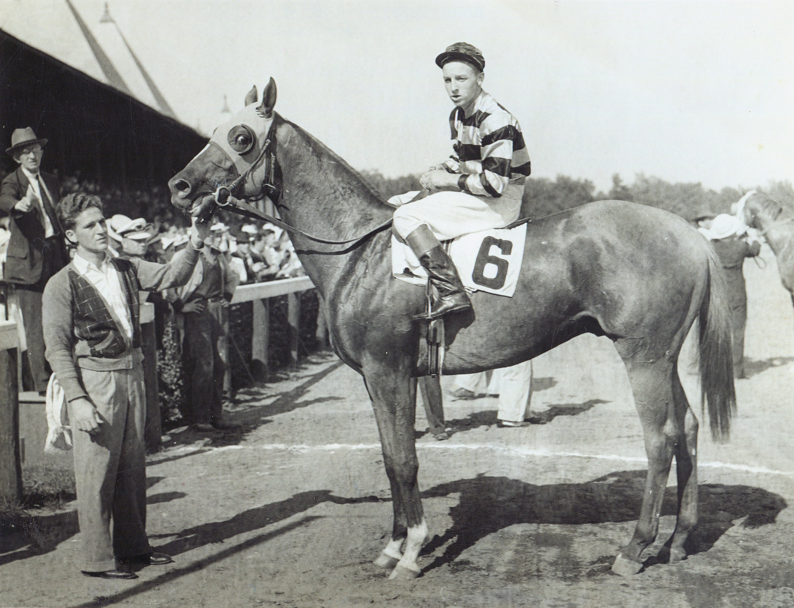 Wayne Wright and Hall of Famer Eight Thirty in the winner's circle for the 1938 Flash Stakes at Saratoga (Turf Pix/Museum Collection)