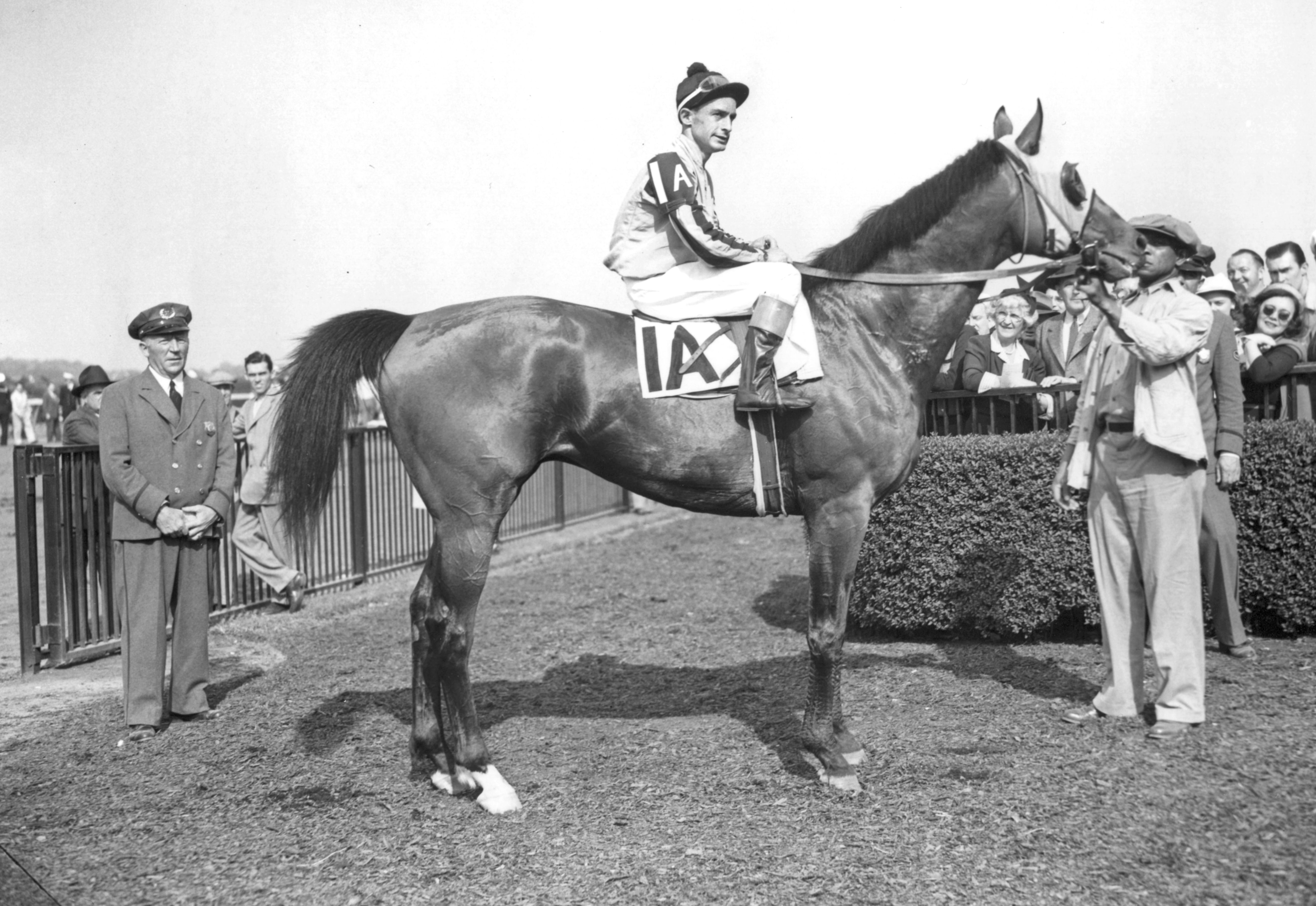 Ted Atkinson and Devil Diver in the winner's circle for the 1944 Metropolitan Handicap at Belmont Park (Keeneland Library Morgan Collection/Museum Collection)