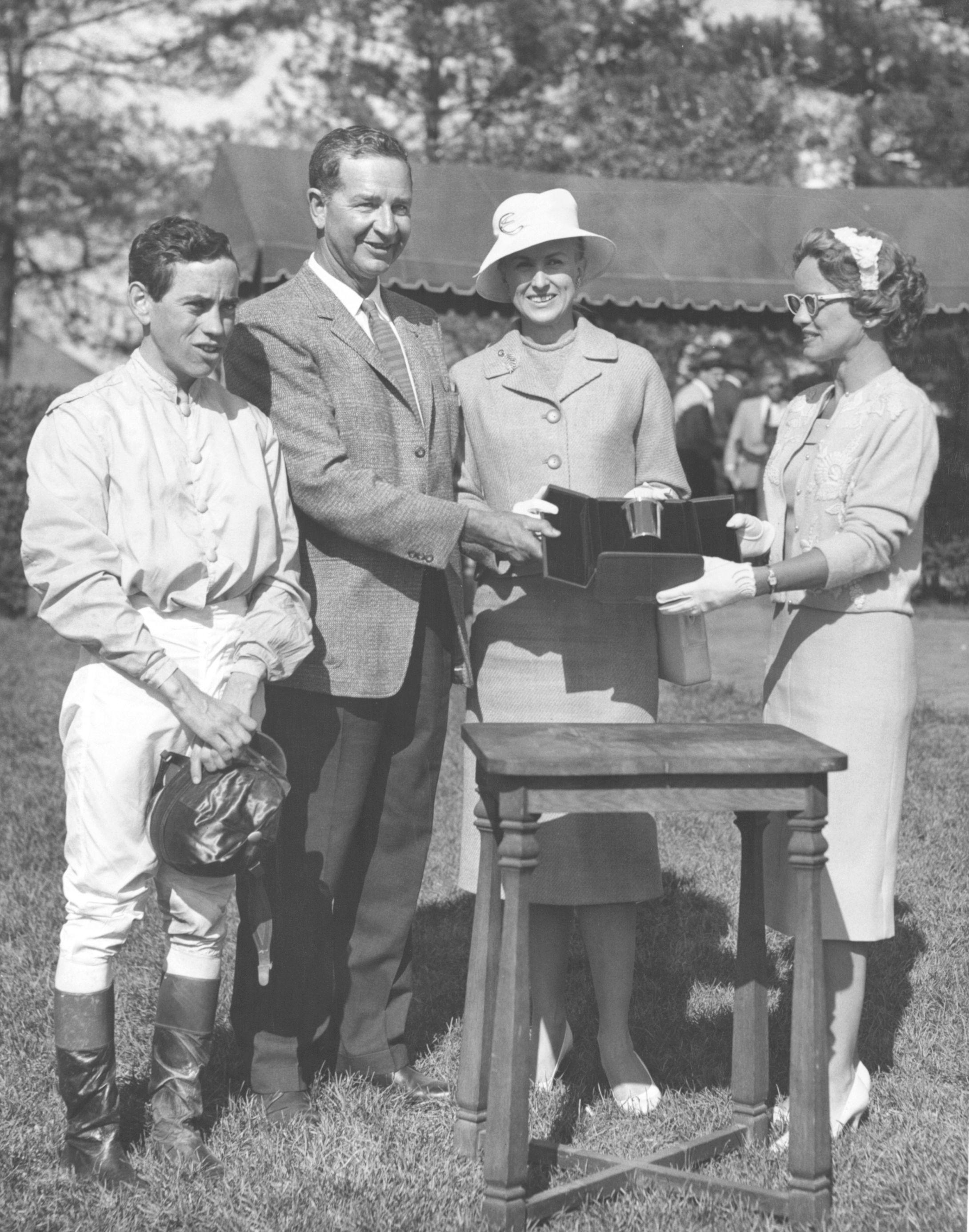 From left, John Rotz, C. V. Whitney, Marylou Whitney, and Mrs. Len Shouse III at Keeneland, 1960 (Keeneland Library)
