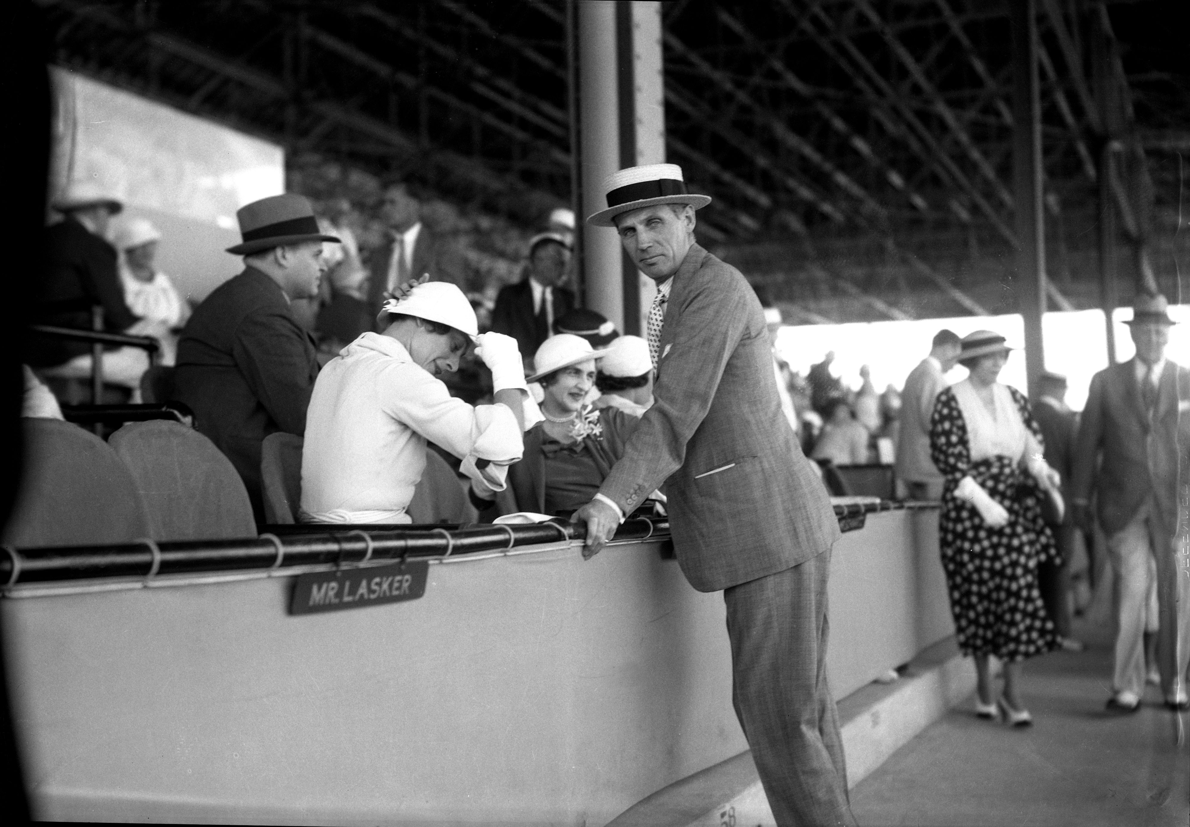 George D. Widener, Jr. visits with Mrs. Isabel Cleves Dodge Sloane in the stands (Keeneland Library Cook Collection)