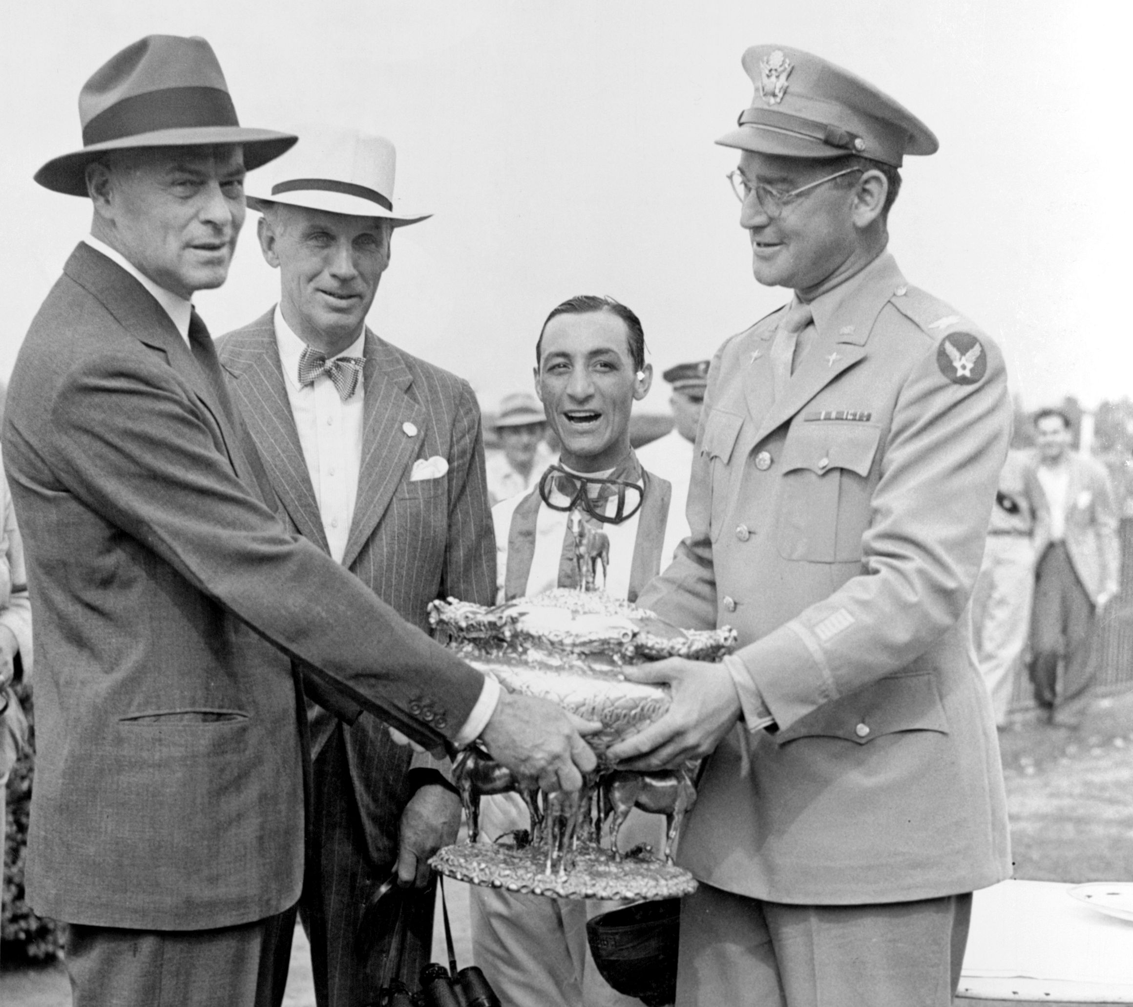 From left, Walter Jeffords, George D. Widener, Jr., Eddie Arcaro, and John Hay Whitney, 1942 Belmont Stakes (Keeneland Library Morgan Collection)