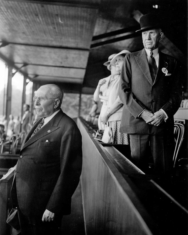 Samuel Riddle (left) and E. R. Bradley (right) in the clubhouse at Saratoga Race Course in 1937 (Bert and Richard Morgan/Museum Collection)