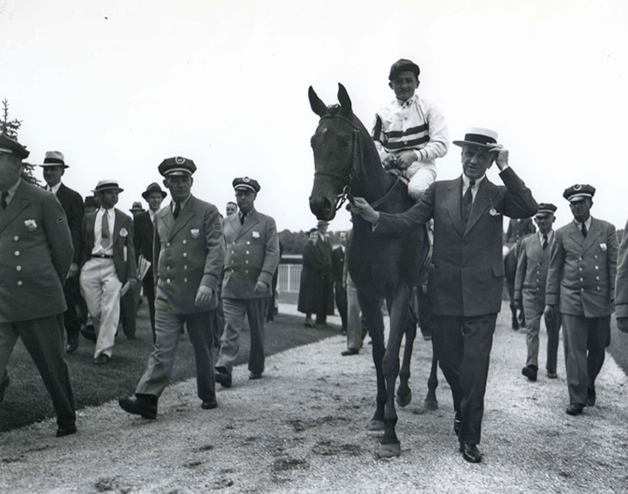 E. R. Bradley leads in Black Helen (Don Meade up) after winning the 1935 Coaching Club American Oaks (Keeneland Library Morgan Collection/Museum Collection)