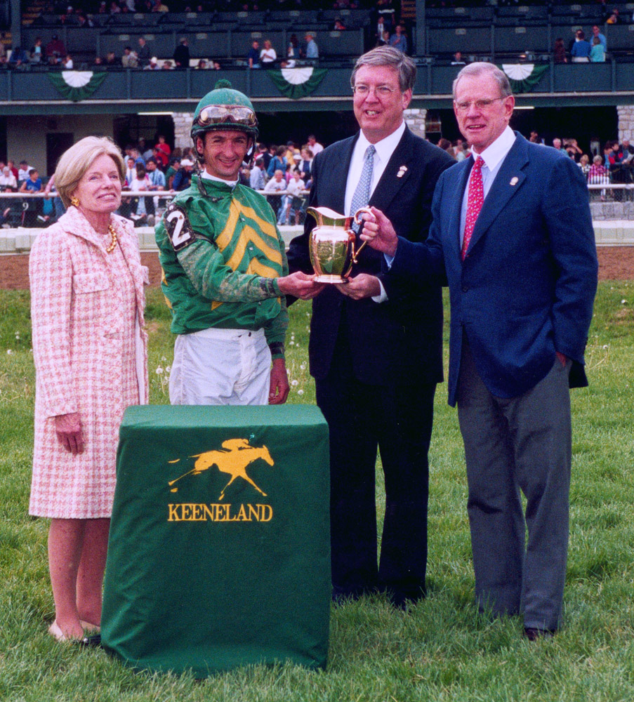 A gold pitcher is presented to Mr. and Mrs. Will Farish after Mineshaft's victory in the Ben Ali at Keeneland, April 2003 (Keeneland Association)