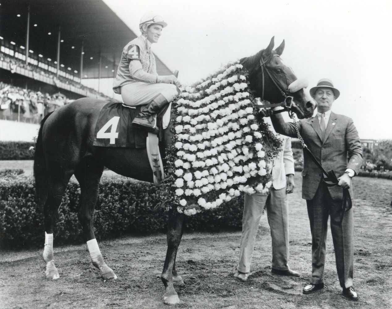 Paul Mellon and Quadrange (Manuel Ycaza up) in the winner's circle for the 1964 Belmont Stakes at Aqueduct (Museum Collection)