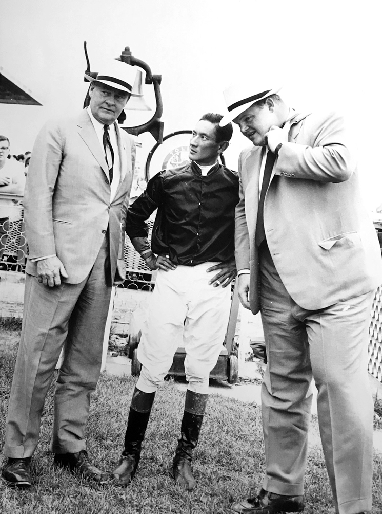 Dinny Phipps (right) with his father Ogden Phipps and jockey Braulio Baeza in 1960 (Keeneland Library Thoroughbred Times Collection)