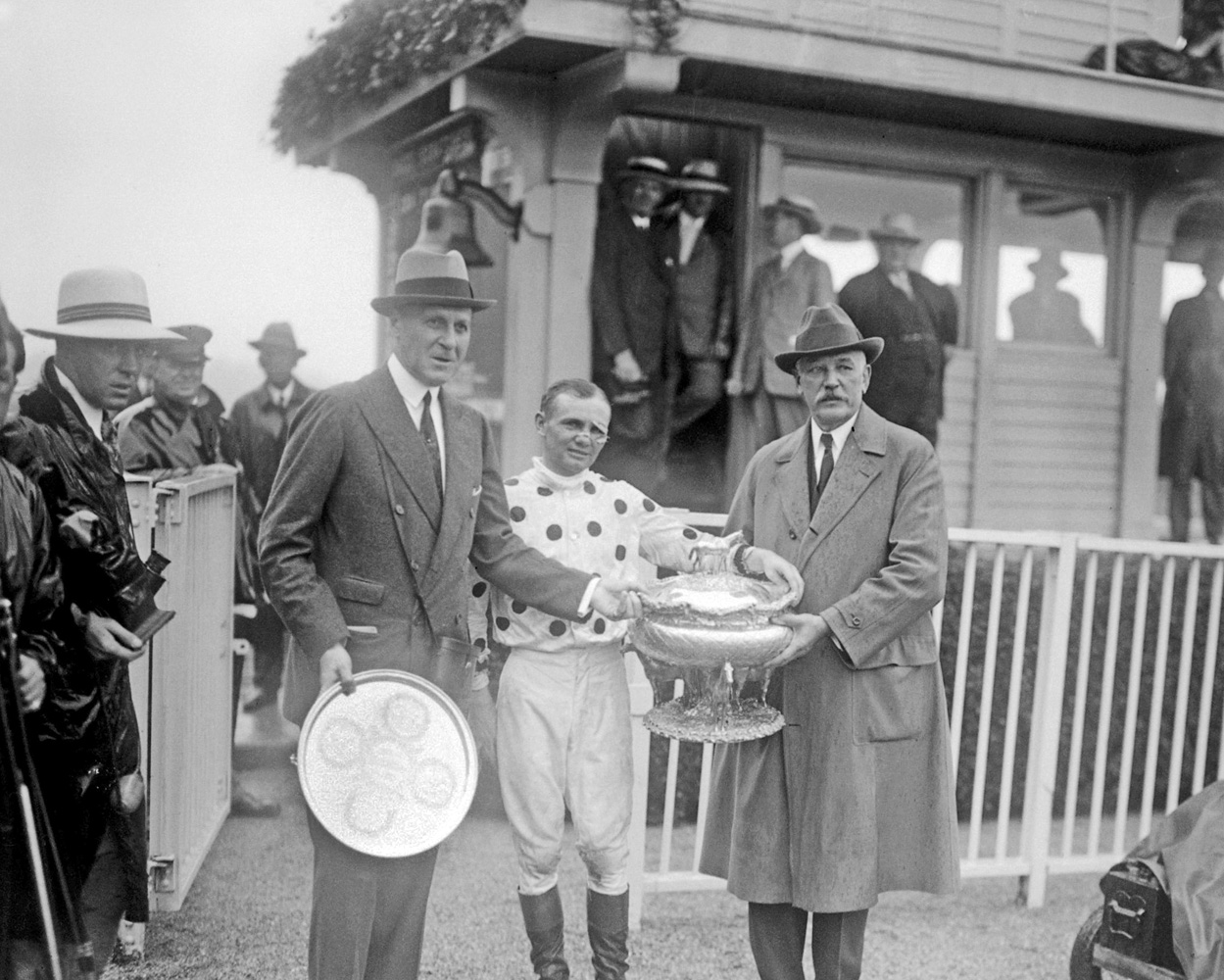 Jockey Earl Sande and owner William Woodward, Sr. receive the Belmont Stakes trophies from Joseph E. Widener after Gallant Fox's victory in 1930 (Keeneland Library Cook Collection)