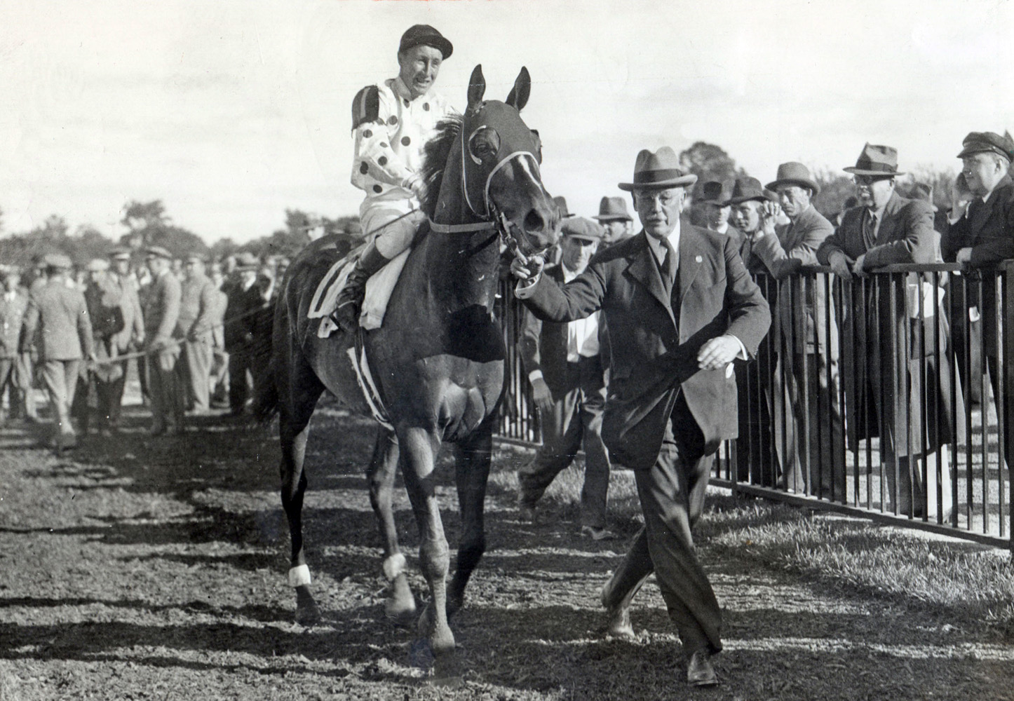 William Woodward, Sr. leads in Granville (James Stout up) after winning a race (Museum Collection)