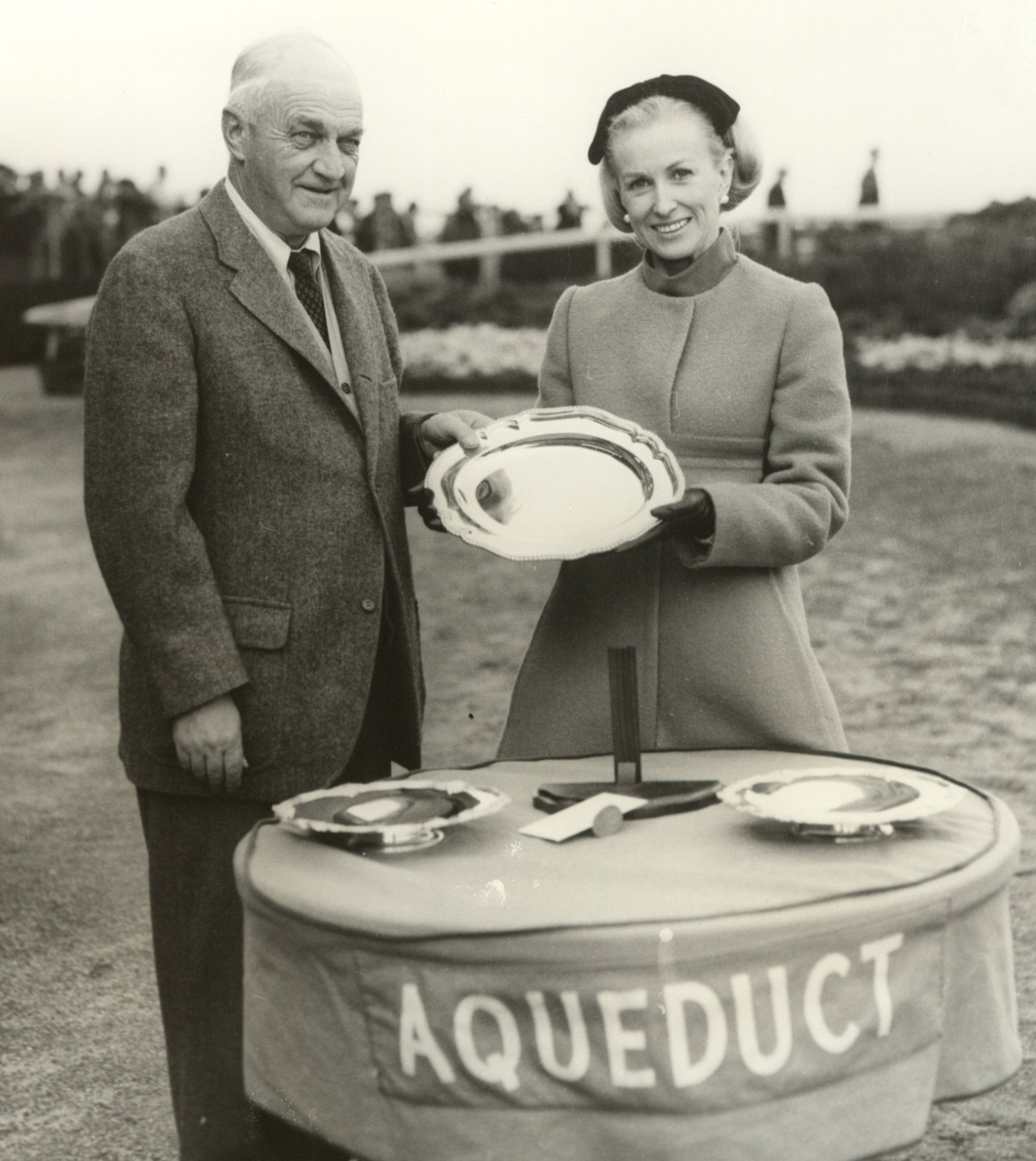 Marylou Whitney and John M. Gaver at Aqueduct, 1967 (Keeneland Library Thoroughbred Times Collection)