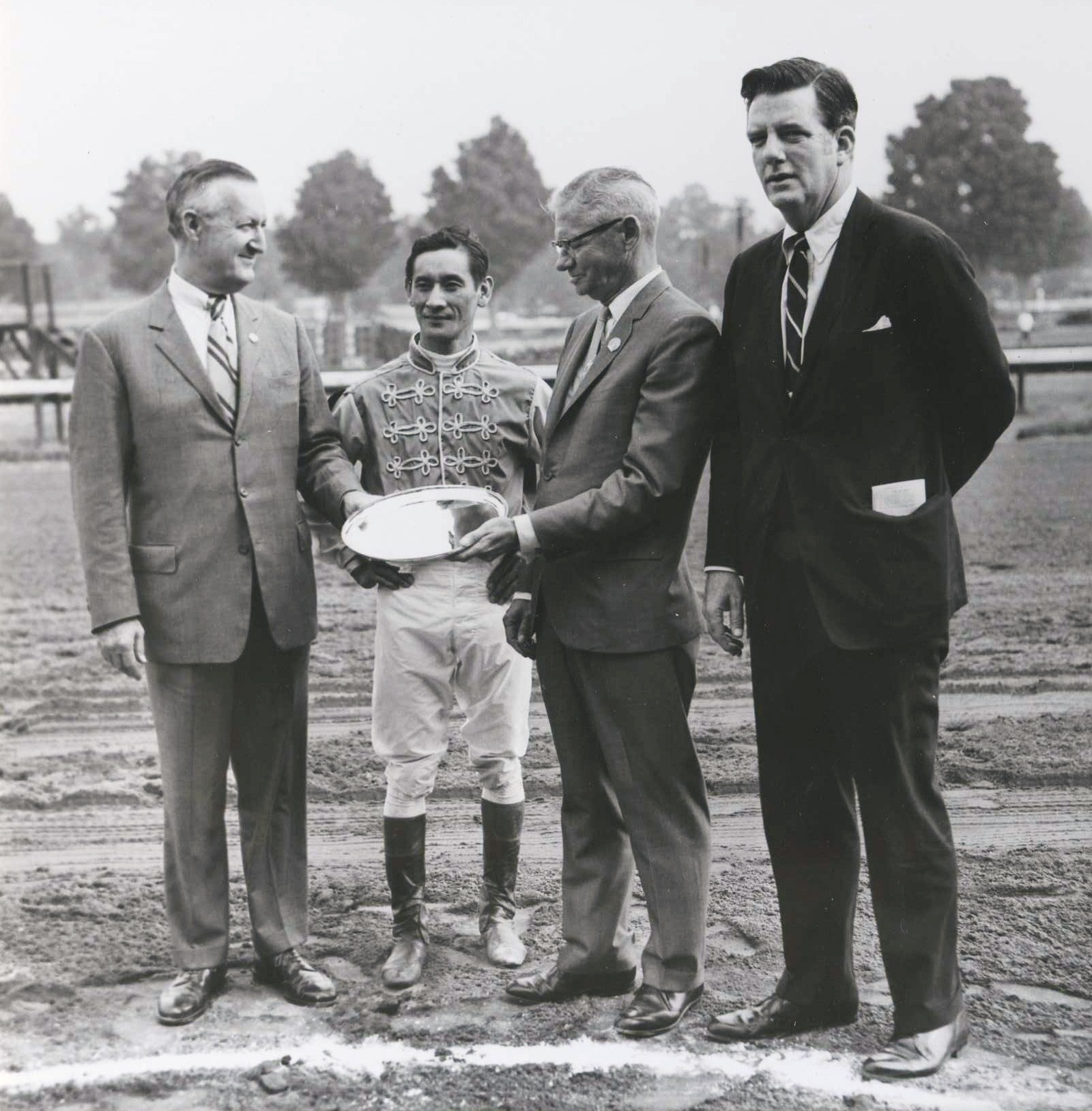 From left, Paul Mellon, Braulio Baeza, the Honorable William L. Pfeiffer, and Elliott Burch at Saratoga for winner's circle presentation after Arts and Letters' Jim Dandy Stakes victory, Aug. 8, 1969 (Museum Collection)