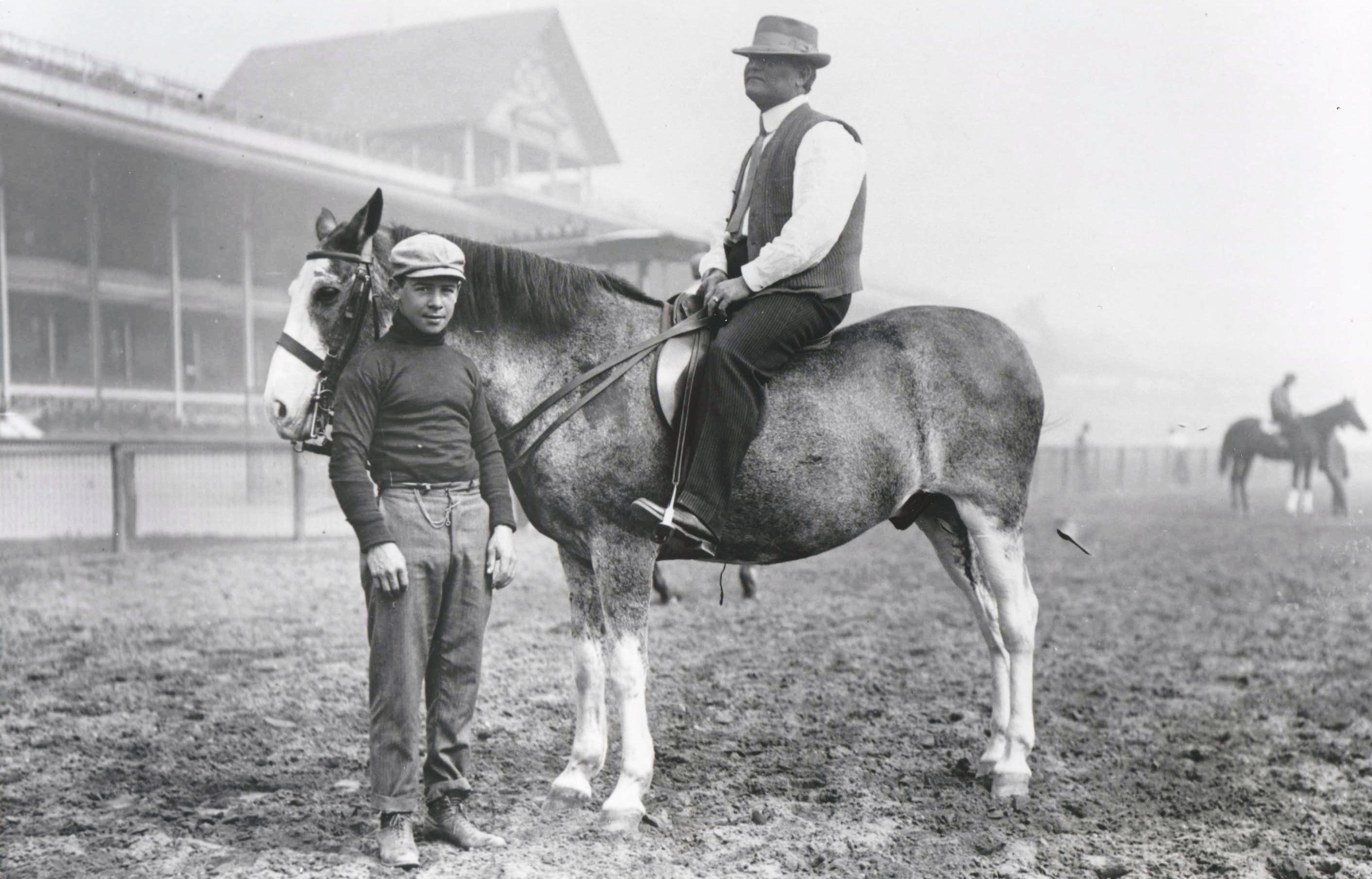 Jockey Joe Notter stands by trainer James G. Rowe, Sr. on horseback (Keeneland Library Cook Collection/Museum Collection)