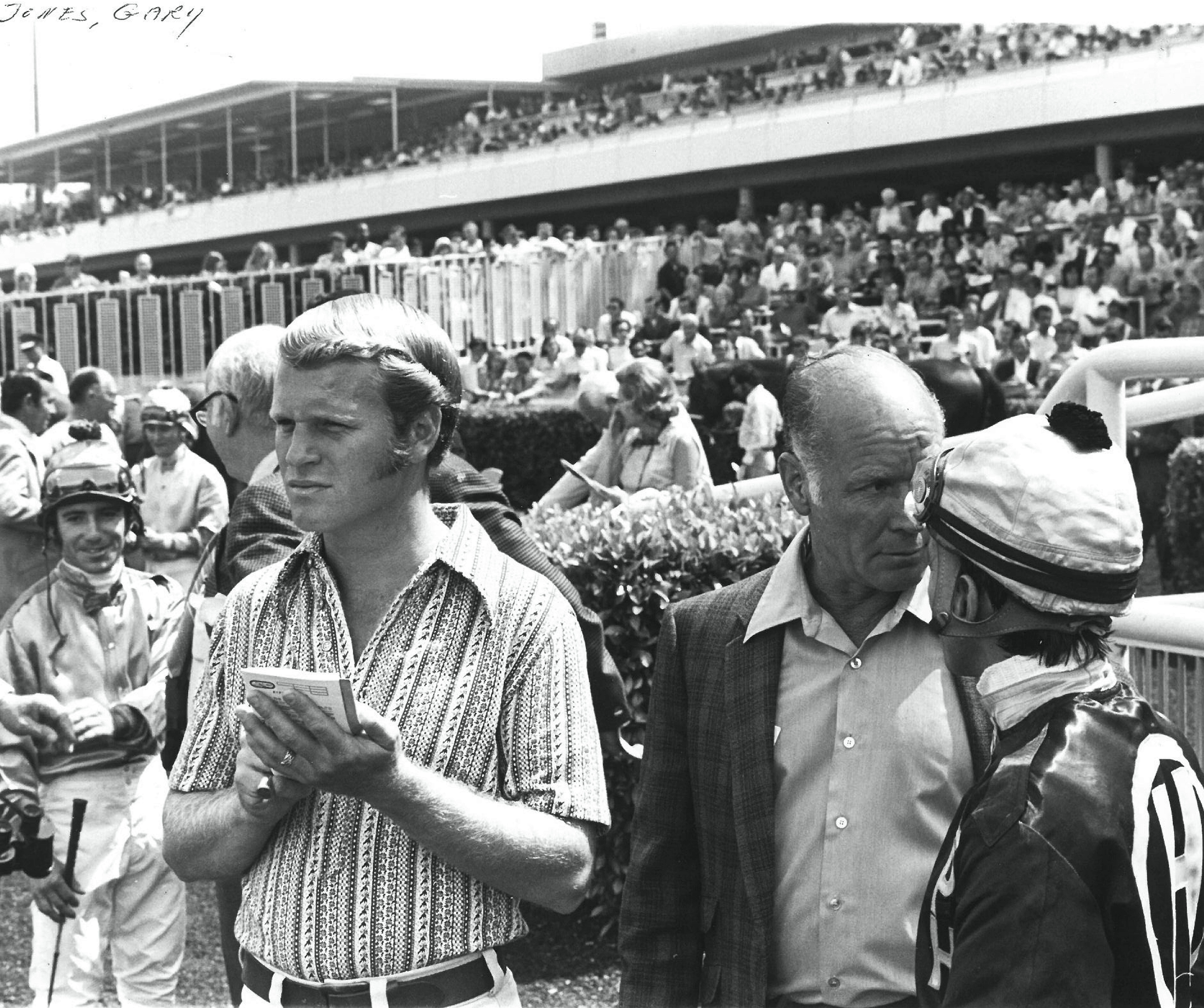 A young Gary Jones at the track with his father, Farrell Jones, amidst the jockey colony before a race (Benoit Photo)