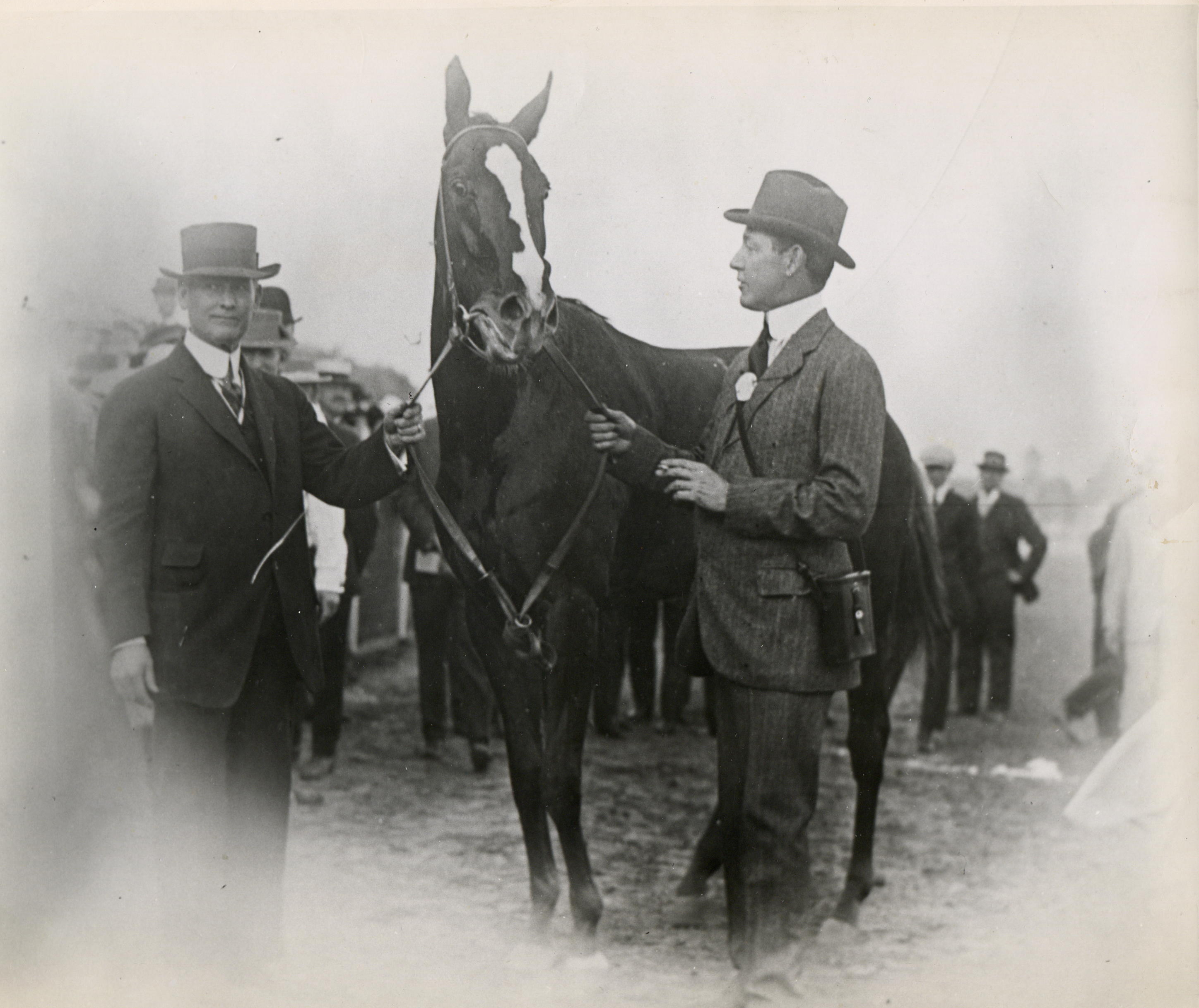 Trainer James G. Rowe, Sr. with Regret and owner Harry Payne Whitney (Museum Collection)