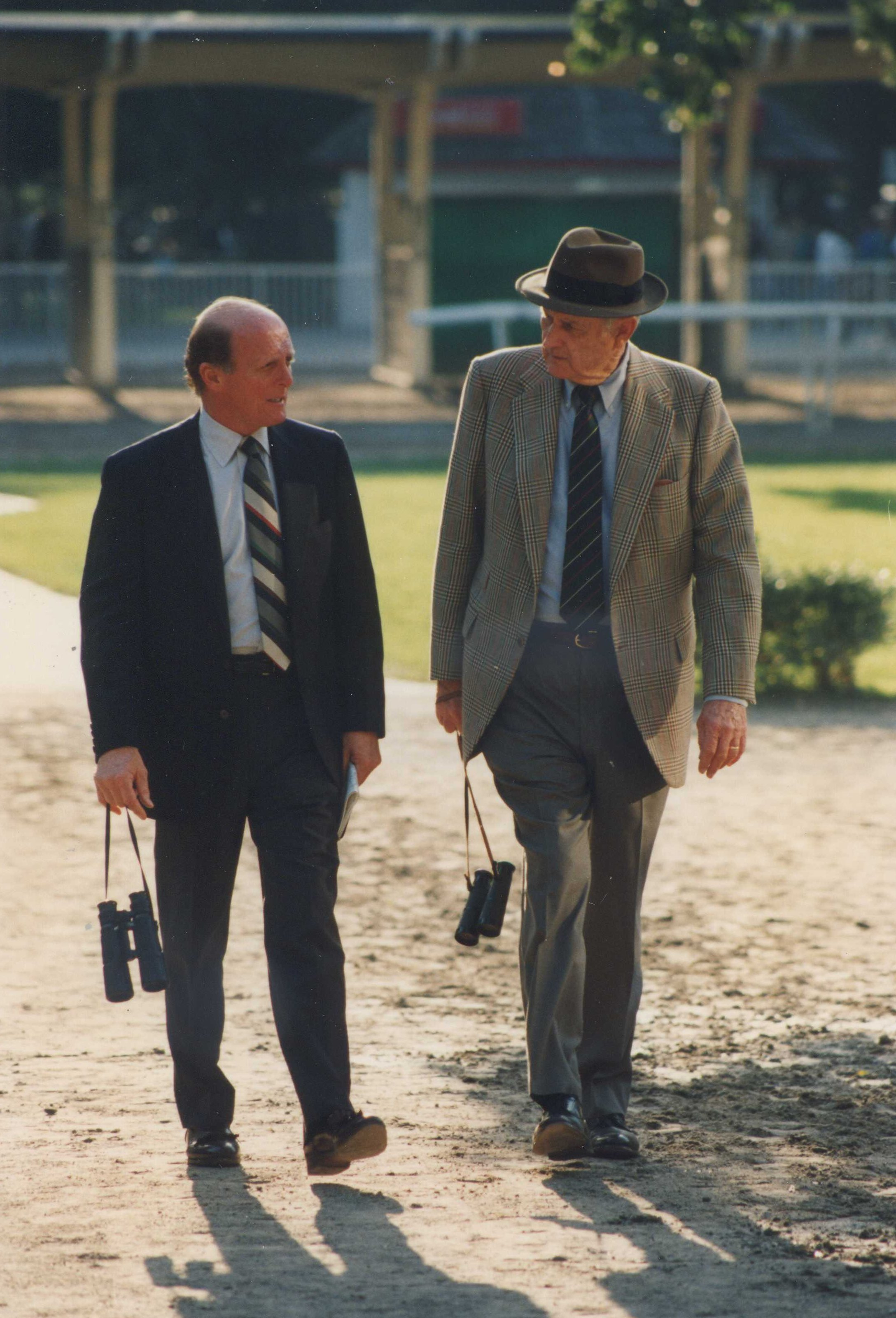 Hall of Fame trainers LeRoy Jolley and MacKenzie Miller walking in the Belmont Park paddock in 1992 (Barbara D. Livingston/Museum Collection)