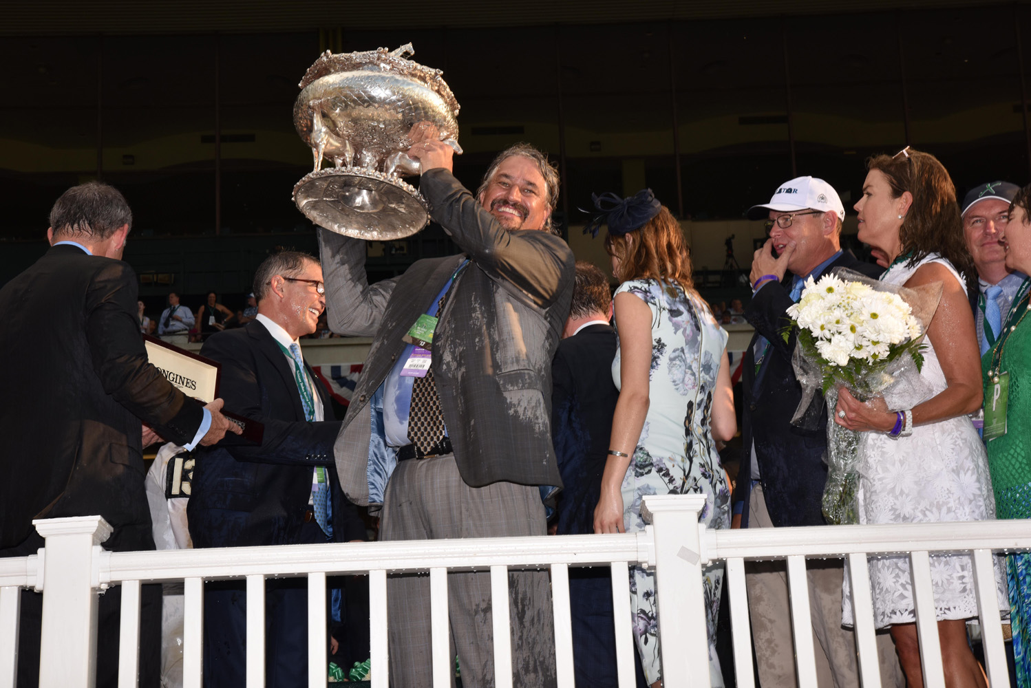 Steve Asmussen holds up the August Belmont Memorial Trophy after winning his first Belmont Stakes with Creator in 2016 (NYRA)