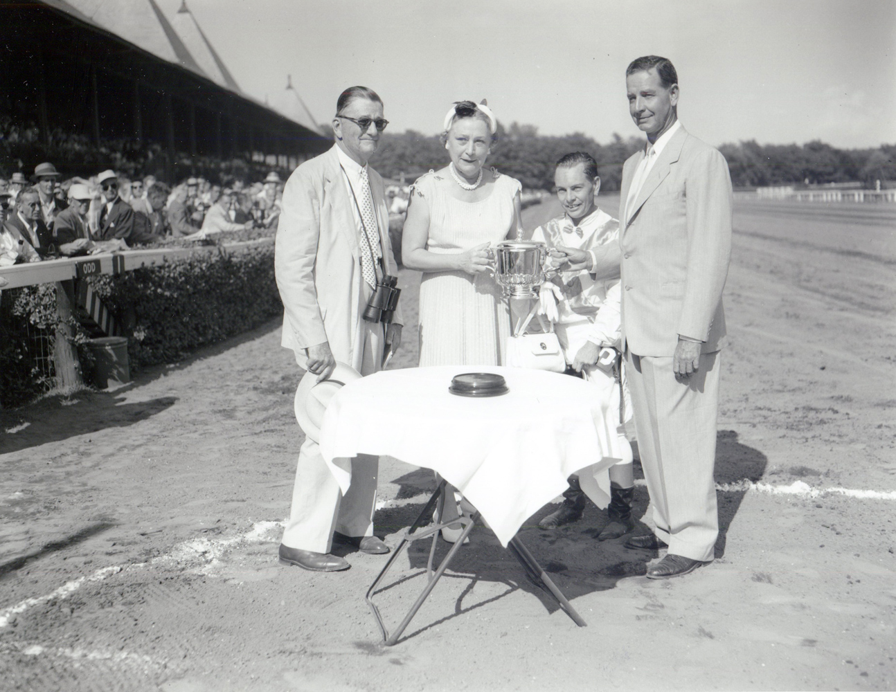 Preston M. Burch, Isabel Dodge Sloane, Hedley J. Woodhouse, and C. V. Whitney at the 1955 Whitney trophy presentation at Saratoga (Keeneland Library Morgan Collection/Museum Collection)