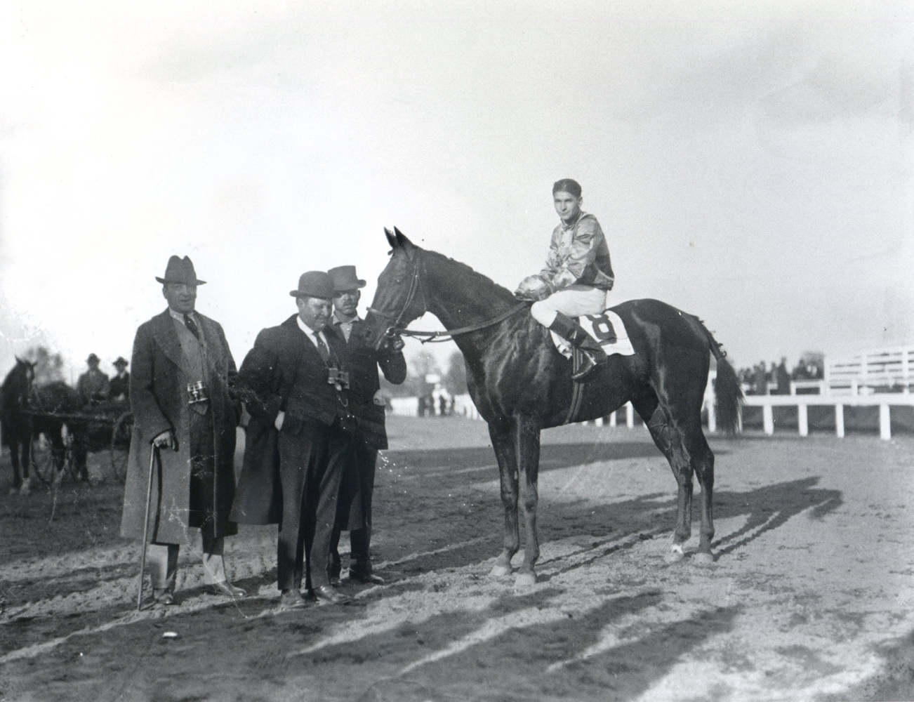 Fred Burlew with Morvich (Albert Johnson up) in the winner's circle for the 1921 Pimlico Futurity (Keeneland Library Cook Collection)