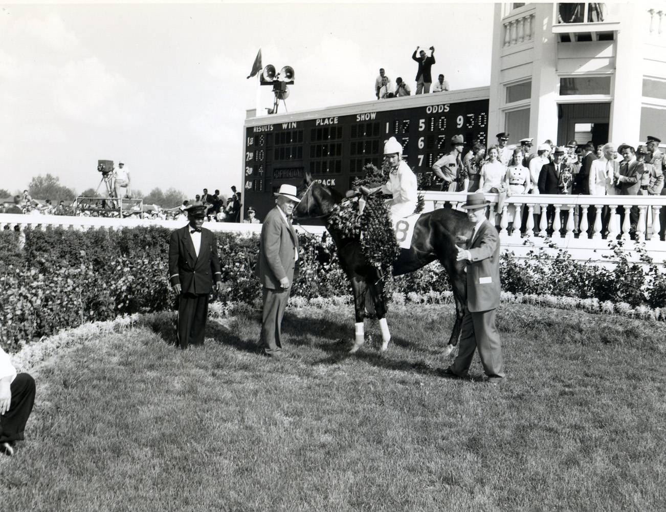 Frank E. Childs in the winner's circle with Tomy Lee (Bill Shoemaker up) for the 1959 Kentucky Derby (Churchill Downs Inc./Kinetic Corp. /Museum Collection)