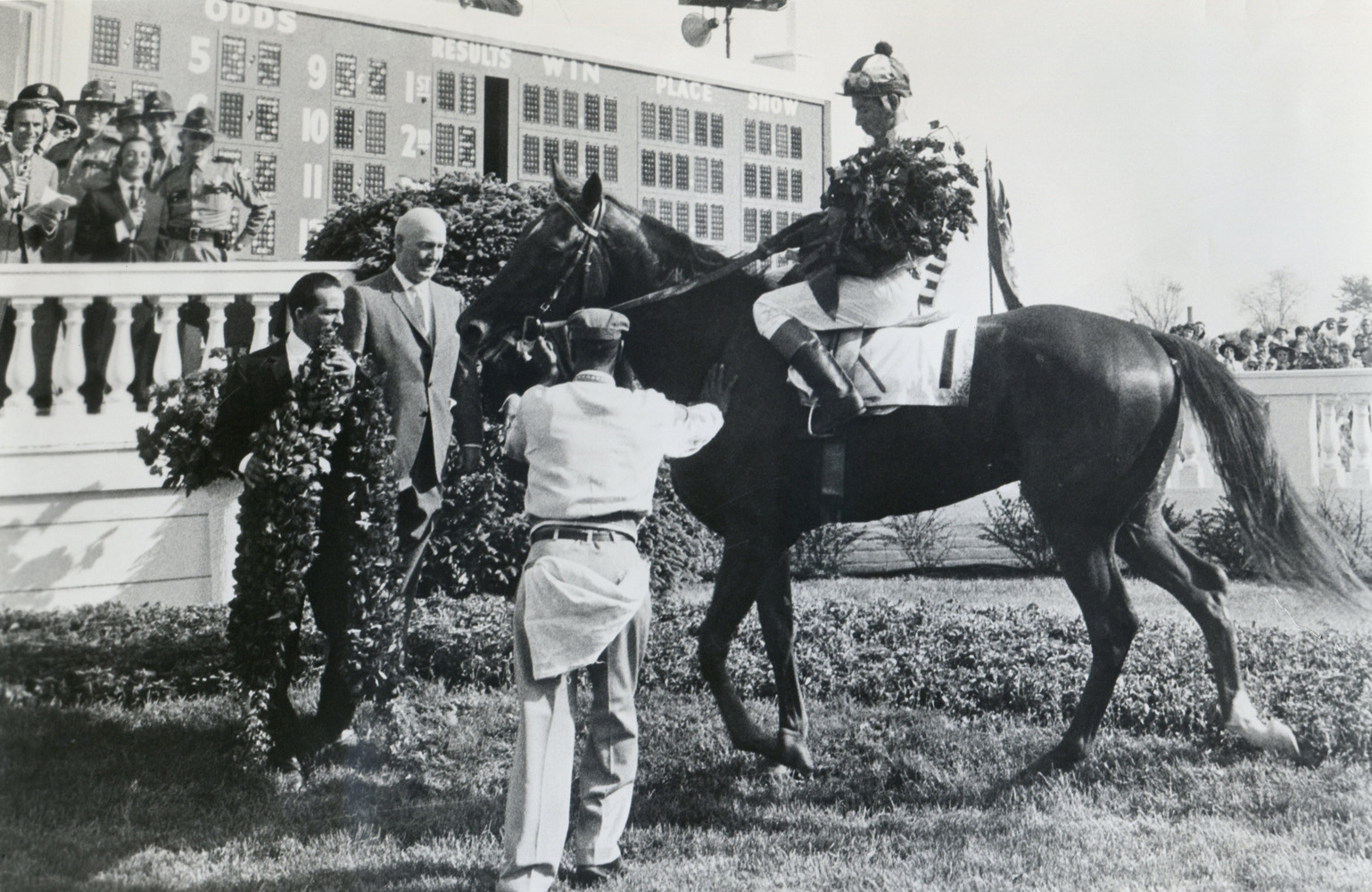 James Conway greets Chateaugay (Braulio Baeza up) in the winner's circle after their 1963 Kentucky Derby win (Museum Collection)