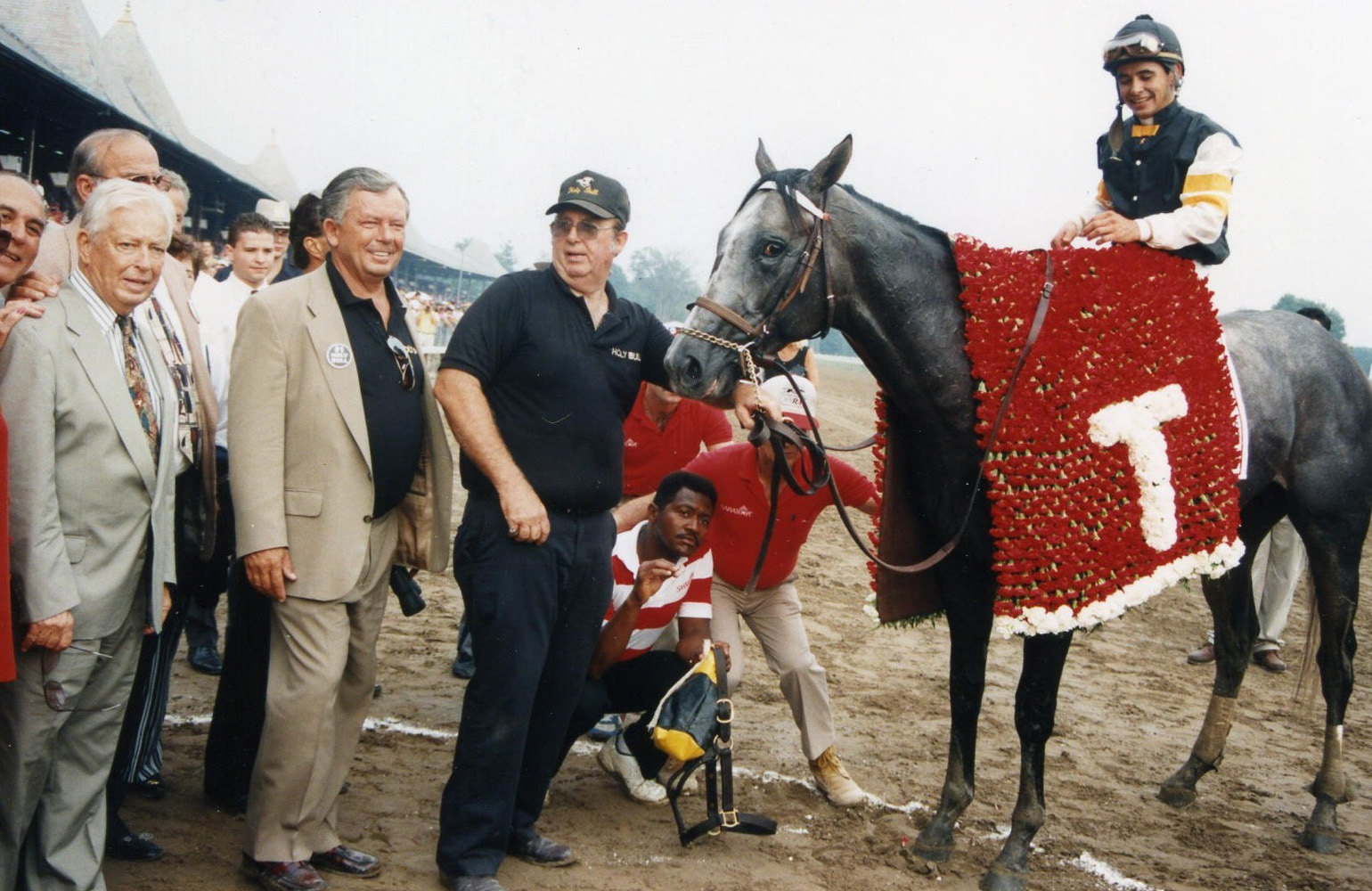Jimmy Croll joins Holy Bull (Mike Smith up) in the winner's circle for the 1994 Travers Stakes (Barbara D. Livingston/Museum Collection)