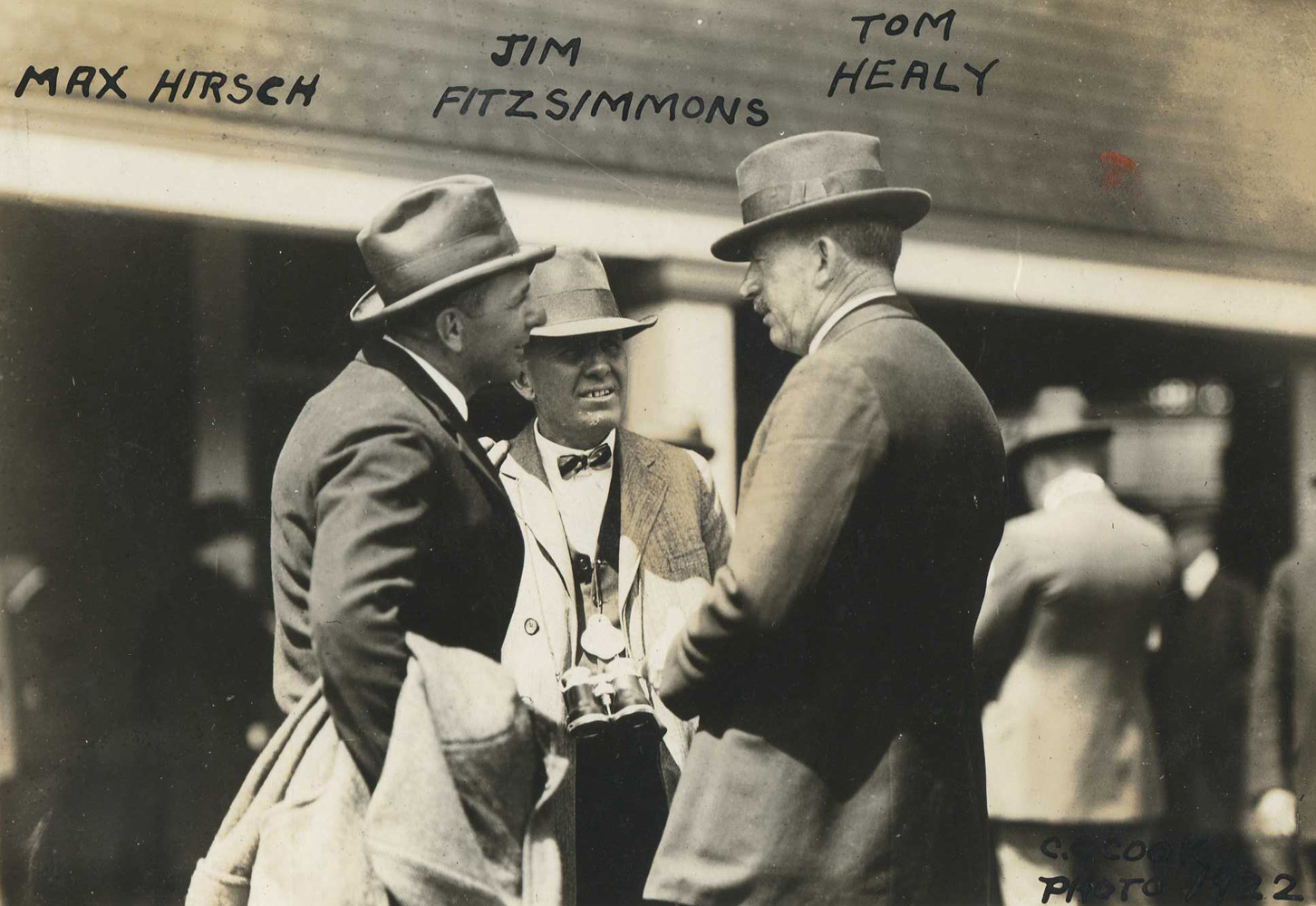 "A young James ""Sunny Jim"" Fiitzsimmons (center) with fellow future Hall of Fame trainers Max Hirsch and T. J. Healey in 1922 (C. C. Cook/Museum Collection)"