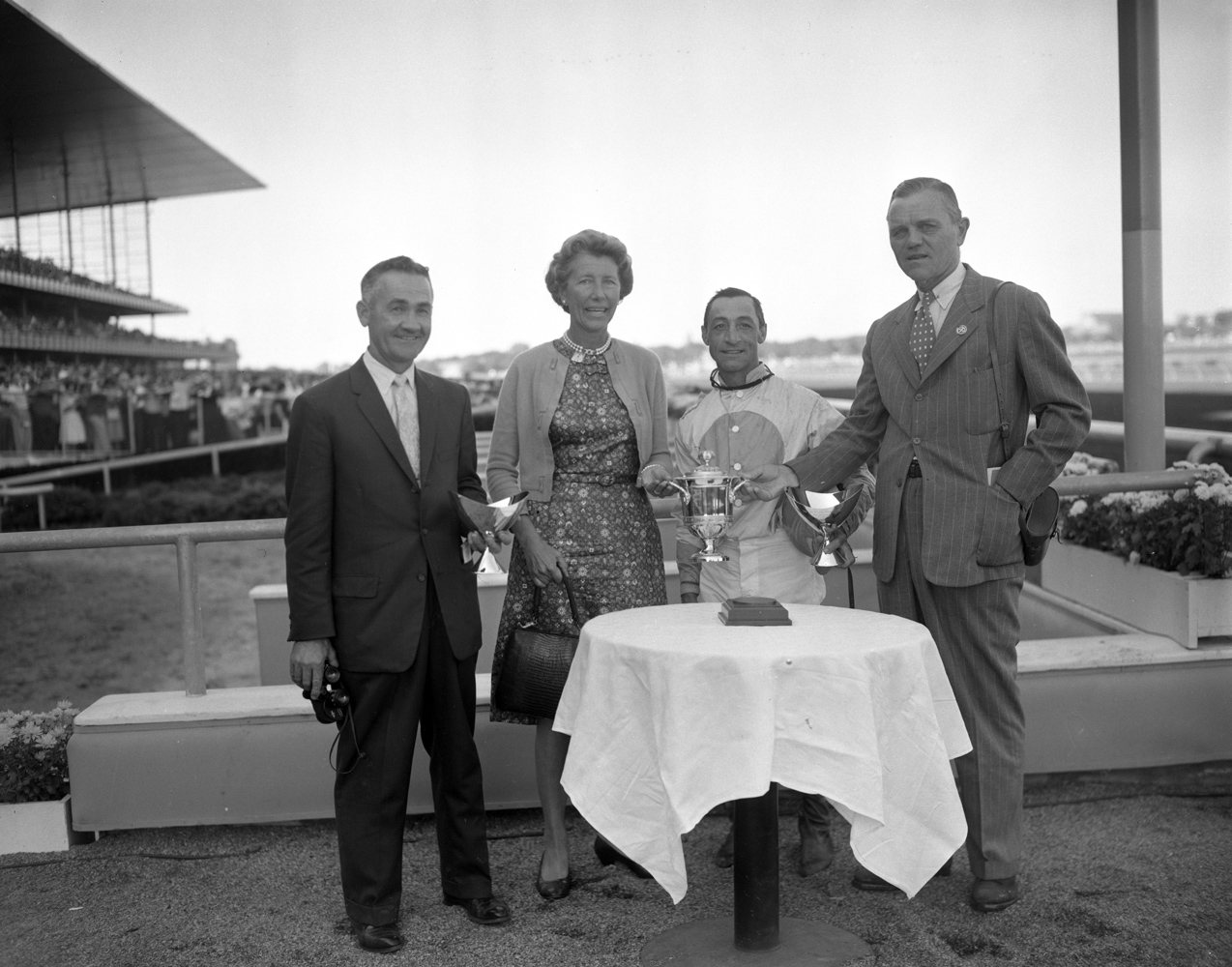 Carl Hanford, Allaire du Ppont, Eddie Arcaro, R. Strawbridge, Jr. at the trophy presentation for Kelso's 1960 Jerome Handicap win at Aqueduct (Keeneland Library Morgan Collection)