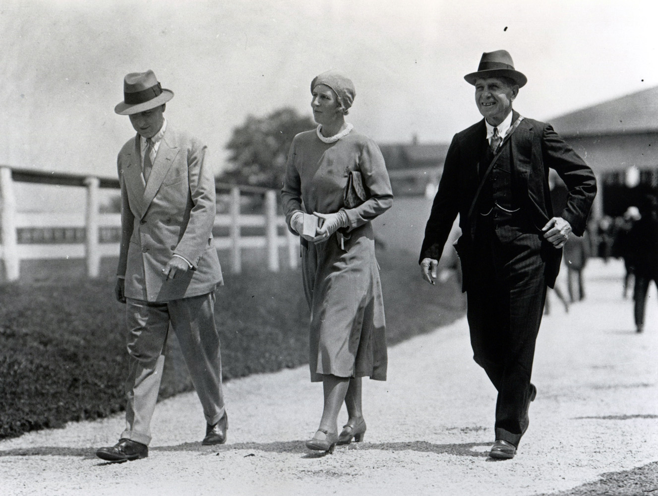 Thomas Hitchcock (on right) walking with an unidentified couple on a farm (Keeneland Library Cook Collection/Museum Collection)