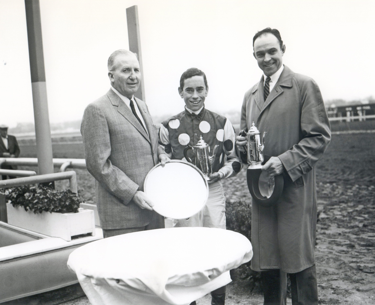 Jockey John Rotz and trainer T. J. Kelly at the trophy presentation for the 1961 Wood Memorial, won by Globemaster (Keeneland Library Morgan Collection/Museum Collection)