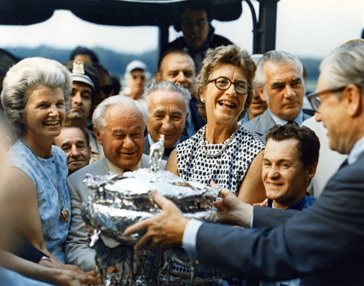 The winning connections of Secretariat receiving the August Belmont Memorial Trophy from New York Governor Nelson Rockefeller after winning the 1973 Belmont Stakes and Triple Crown (Museum Collection)