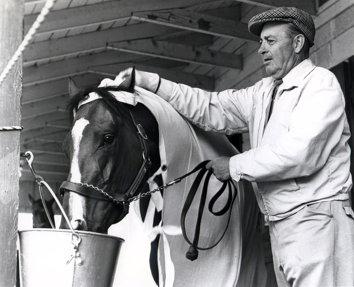 Horatio Luro and Northern Dancer in the barns at Woodbine in 1964 (Michael Burns/Museum Collection)