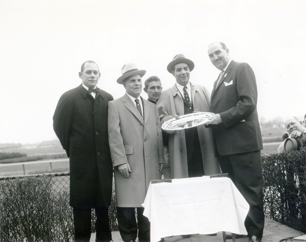 Frank Martin, Mr. Dolce, jockey Ray Broussard, Emil Dolce, and Queens Borough President John T. Clancy at the 1959 Wood Memorial trophy presentation at Jamaica (Keeneland Library Morgan Collection/Museum Collection)
