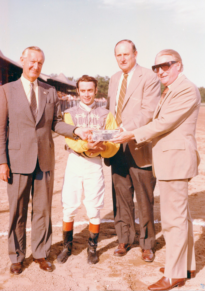 Paul Mellon, jockey Michael Venezia, and trainer Mack Miller receive the trophy for the 1977 Jim Dandy (won by Music of Time) at Saratoga Race Course (Bert and Richard Morgan/Museum Collection)