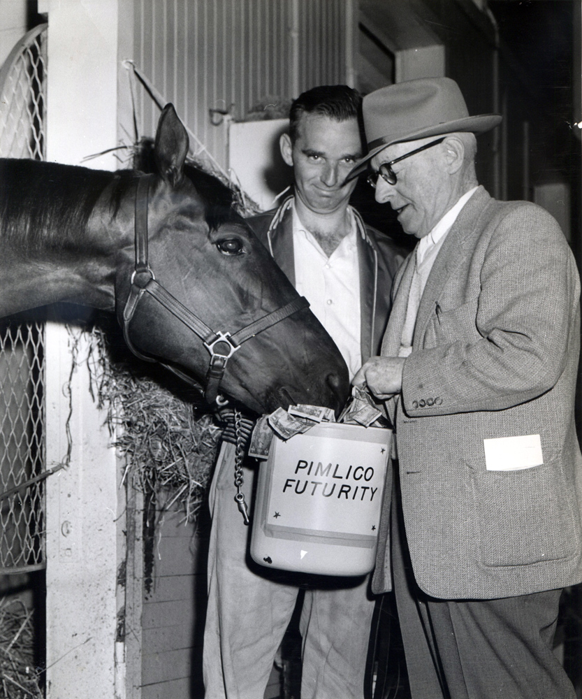 Bert Mulholland shares the Pimilico Futurity winnings with Jester (Pimlico Photo/Museum Collection)