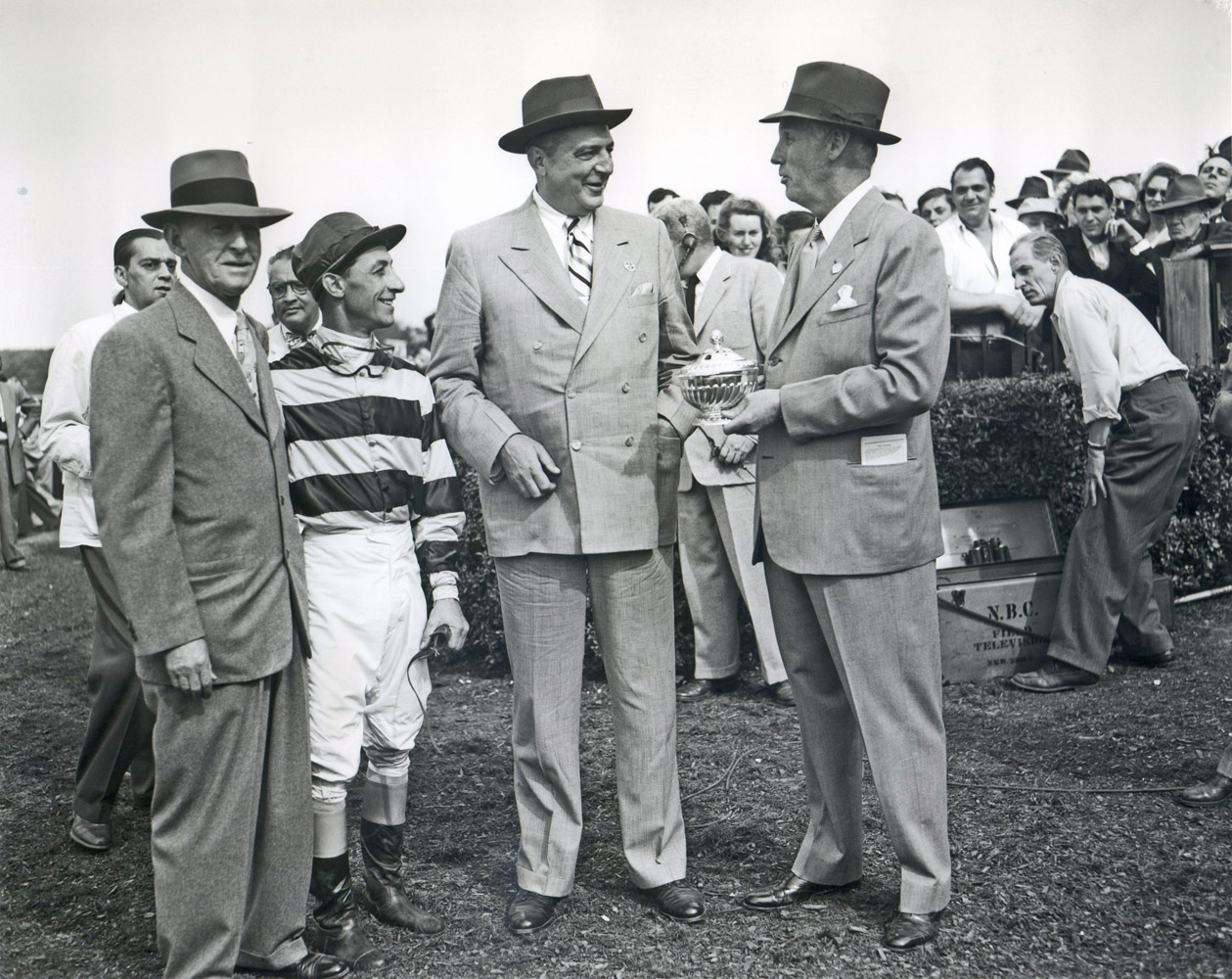 Trainer Bert Mulholland, jockey Eddie Arcaro, and owner George D. Widener, Jr. accept the trophy for the 1951 Withers Stakes at Belmont Park, won by Battlefield (Keeneland Library Morgan Collection/Museum Collection)