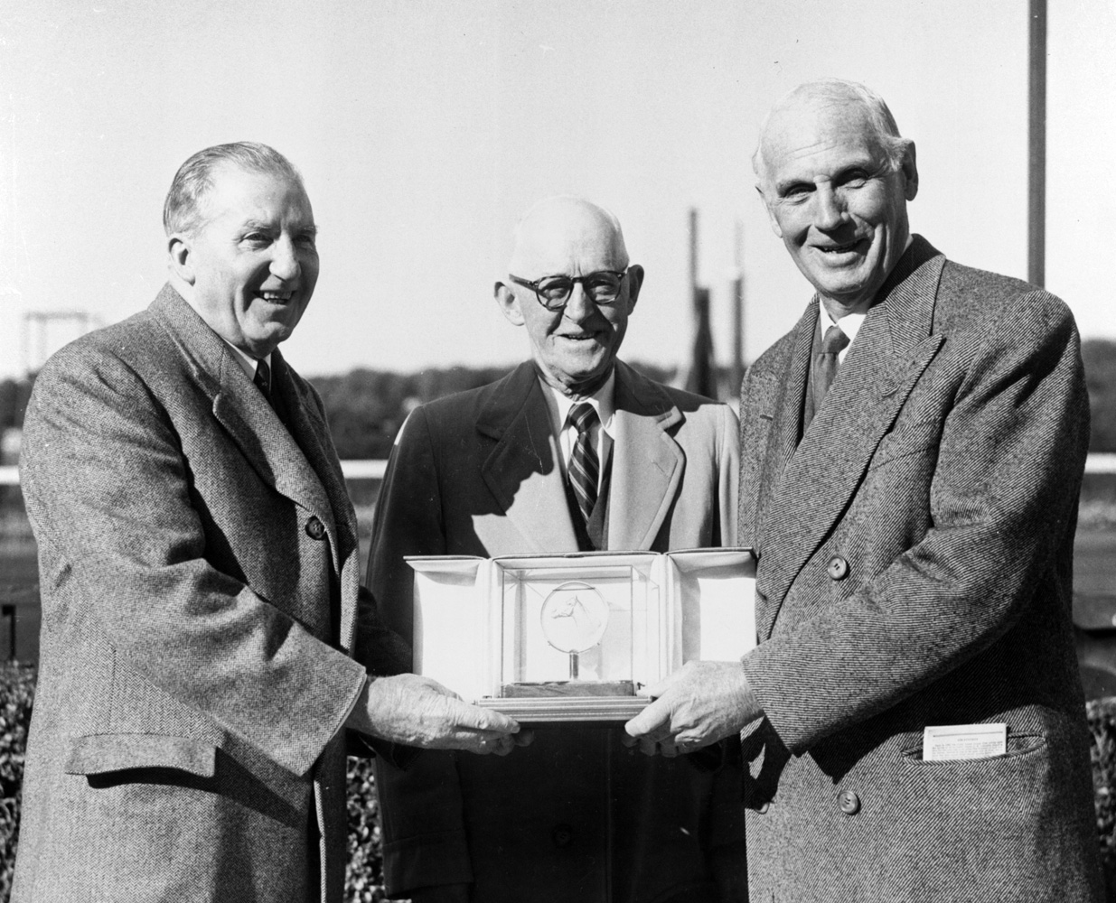 John W. Hanes, W. F. Bert Mulholland, and George D. Widener, Jr. at the trophy presentation for the 1957 Belmont Futurity, won by Jester (Keeneland Library Morgan Collection)