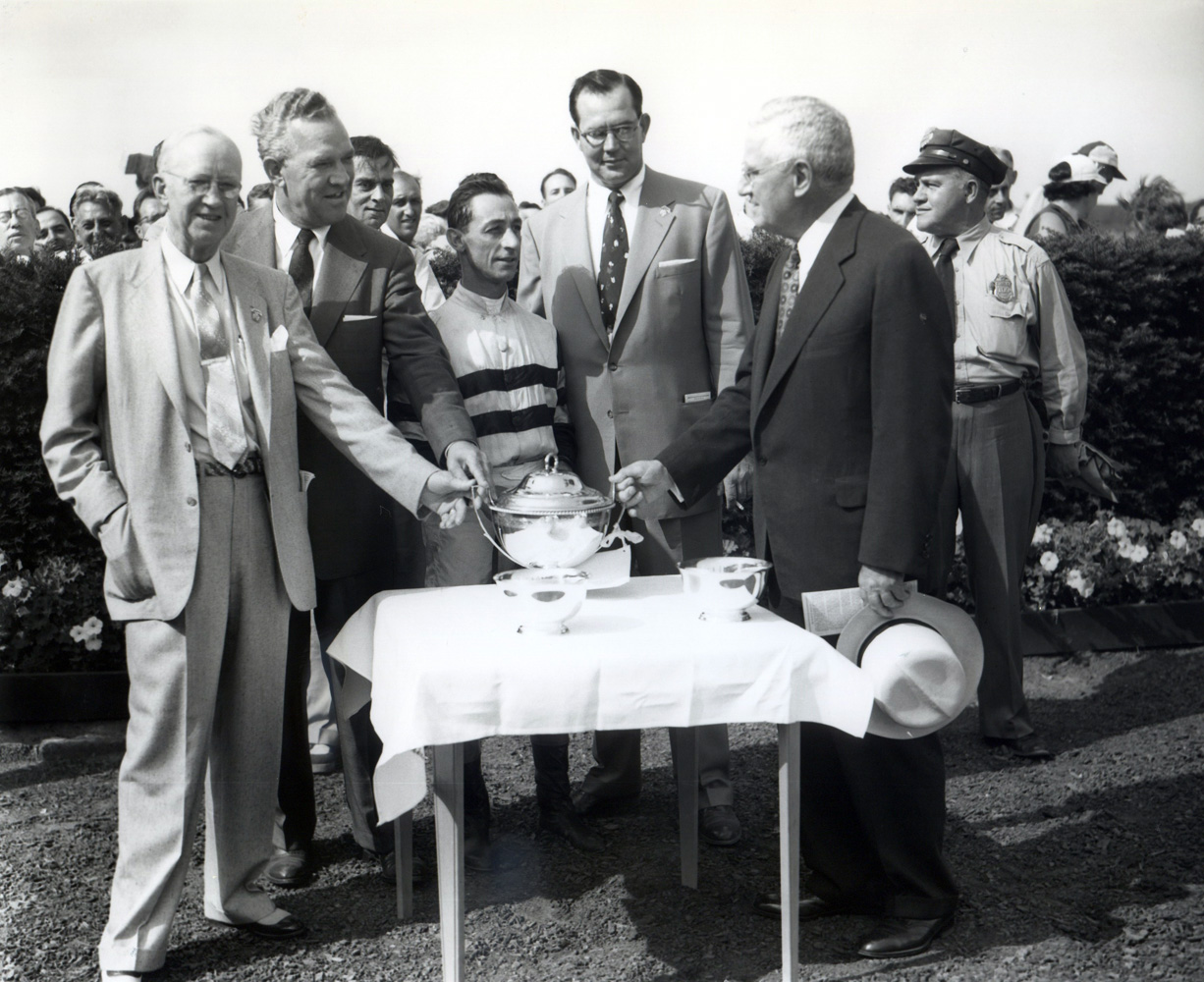 Jockey Eddie Arcaro and trainer Eddie Neloy join others in a post-victory trophy presentation (Keeneland Library Morgan Collection/Museum Collection)