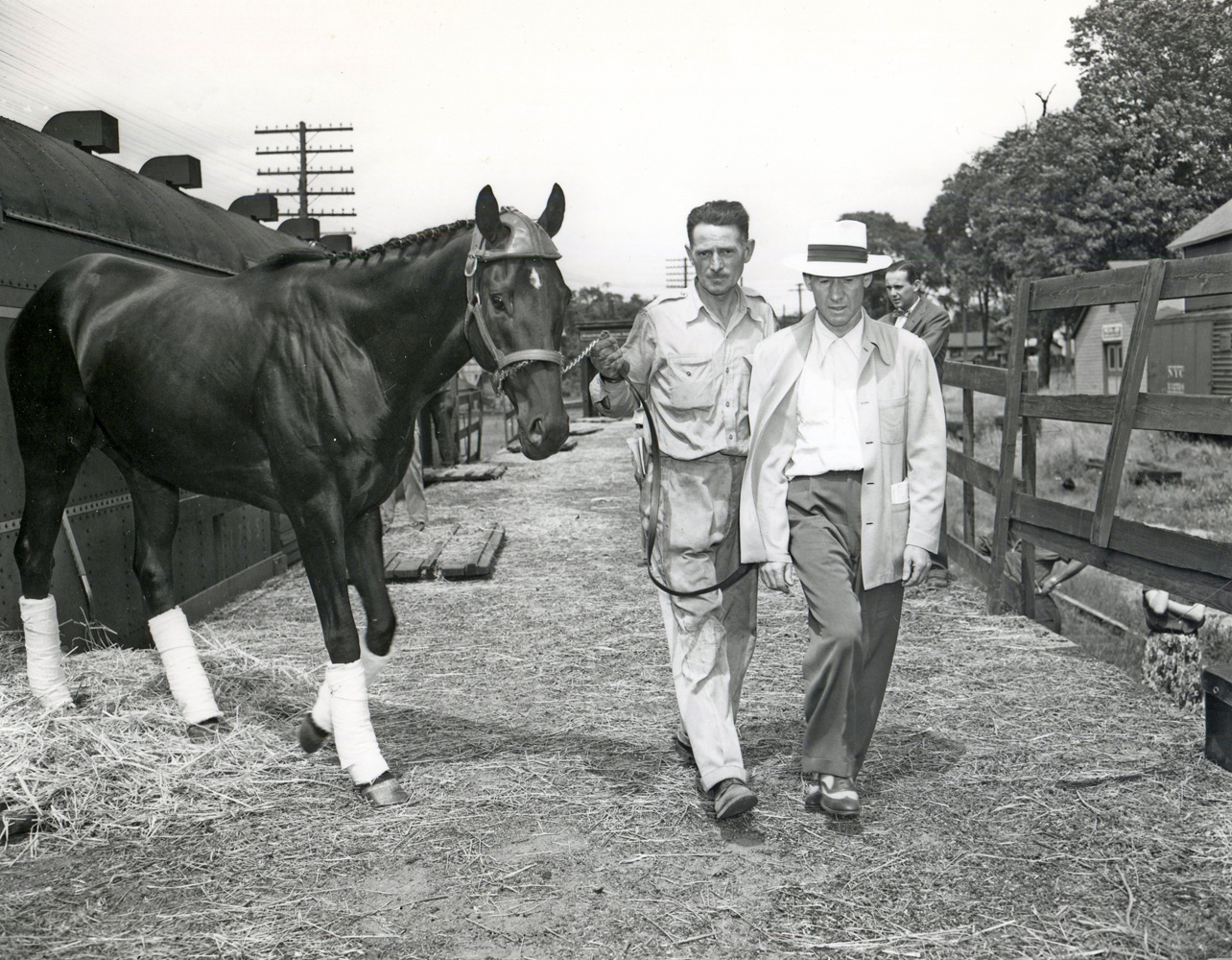 Noor arriving by train at Saratoga with trainer Burley Parke, August 1950 (Keeneland Library Morgan Collection/Museum Collection)