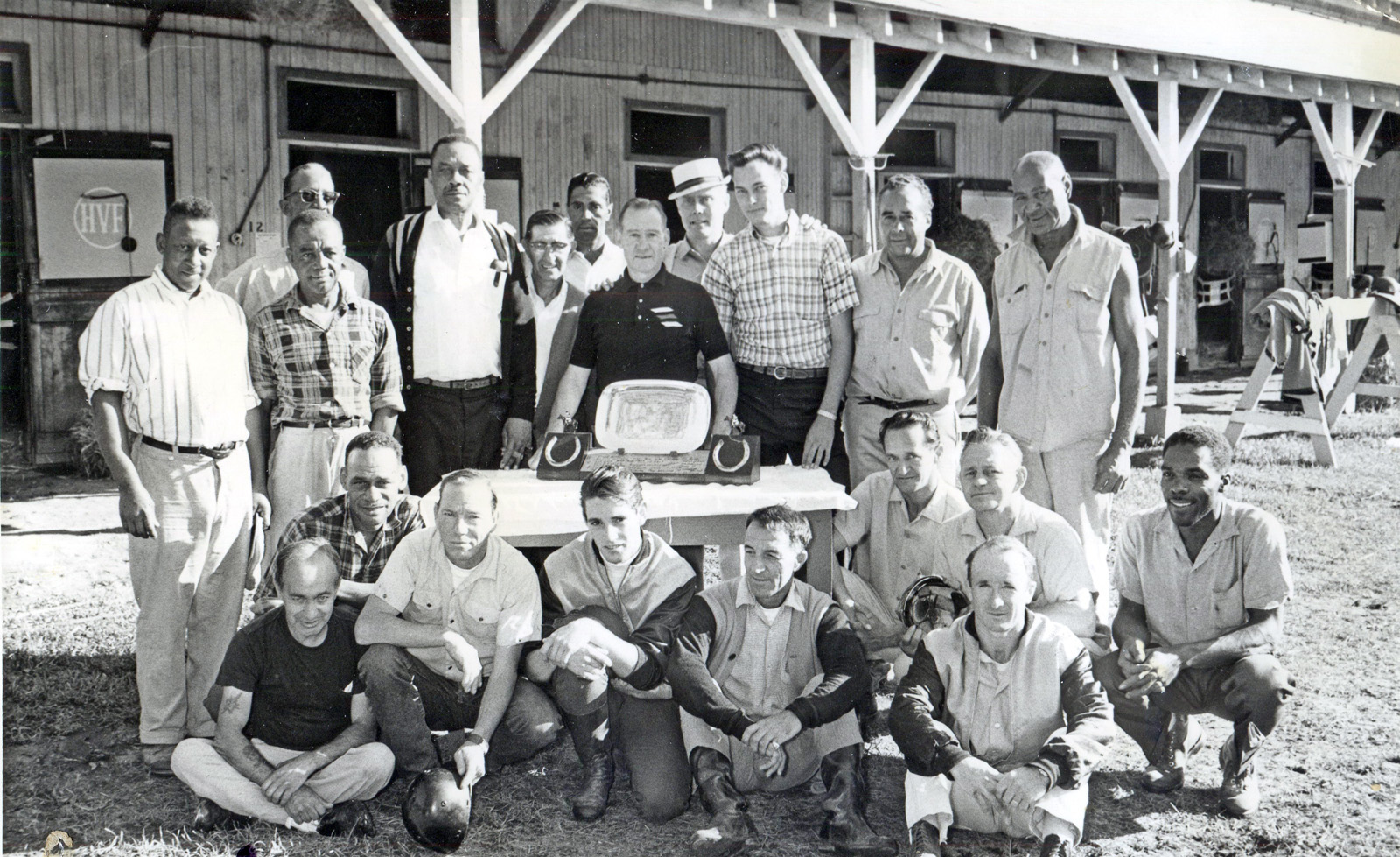 Harbor View Farm group photo at a surprise farewell trophy presentation for Burley Parke on the occasion of his retirement (Parke in center with trophy) (NYRA/Jim Sargent /Museum Collection)