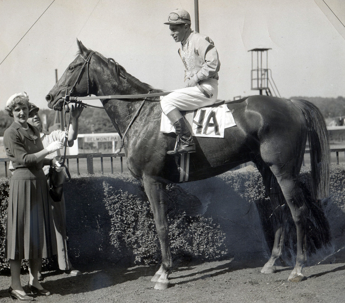 "Jockey Flint S. ""Scotty"" Schulhofer and Neji in the winner's circle for the 1955 International Steeplechase at Belmont Park (Bert Morgan/Museum Collection)"