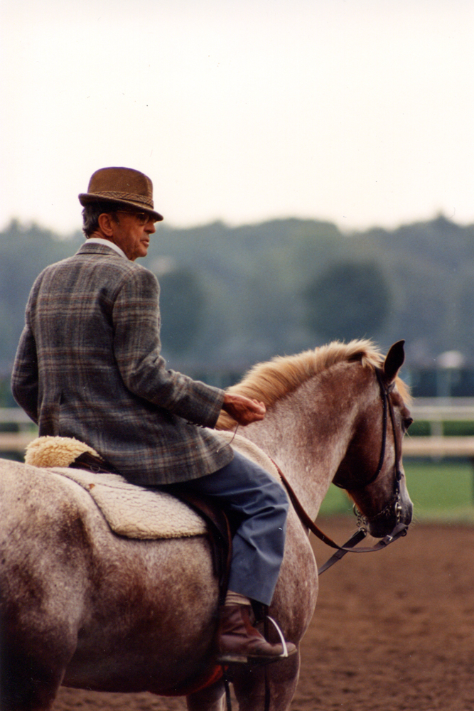 Woody Stephens on the track clocking a workout at Saratoga, August 1987 (Barbara D. Livingston/Museum Collection)