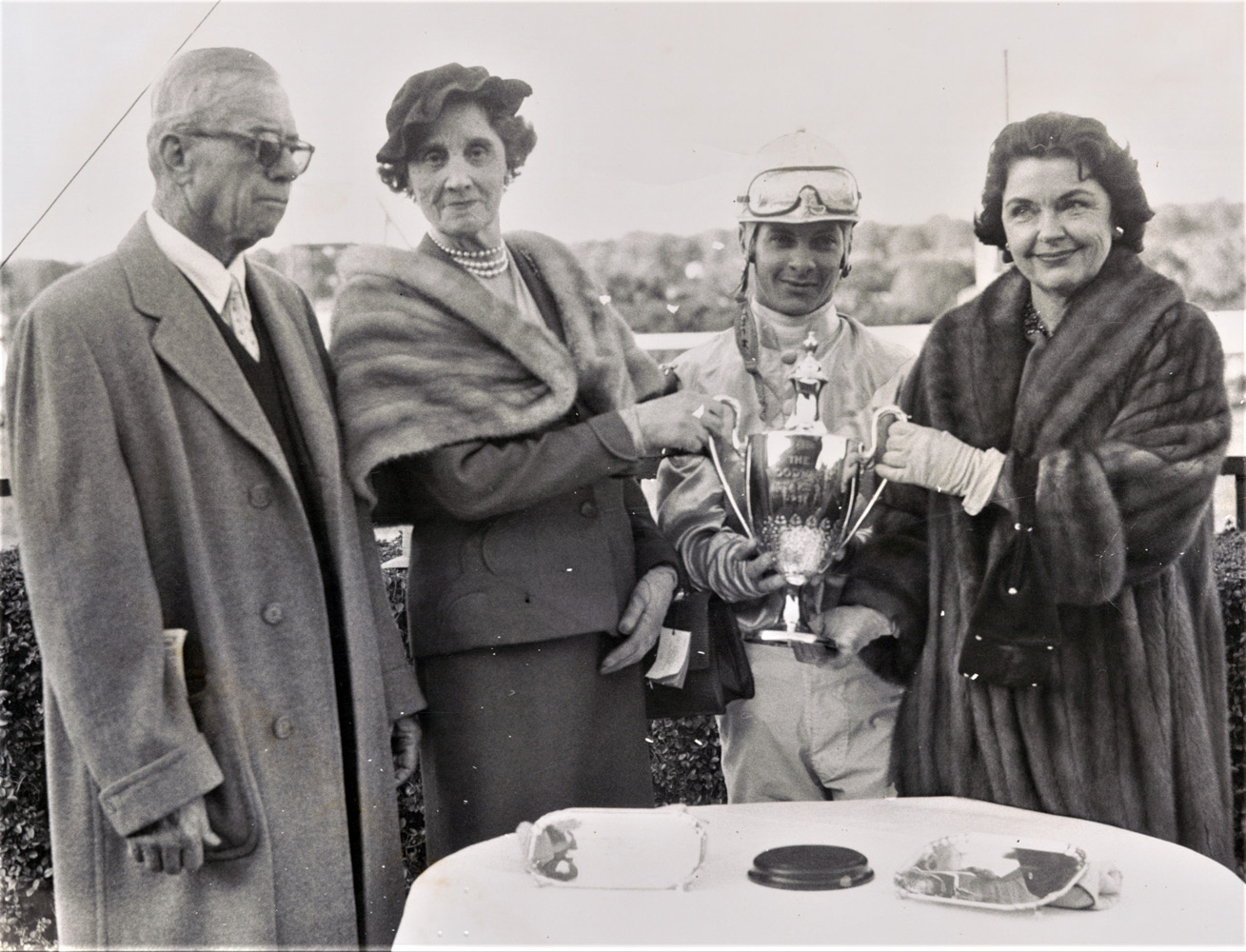 G. Carey Winfrey, Mrs. William Woodward, Sr., Bill Hartack, and Mrs. Jan Burke at a trophy presentation (Keeneland Library Morgan Collection)
