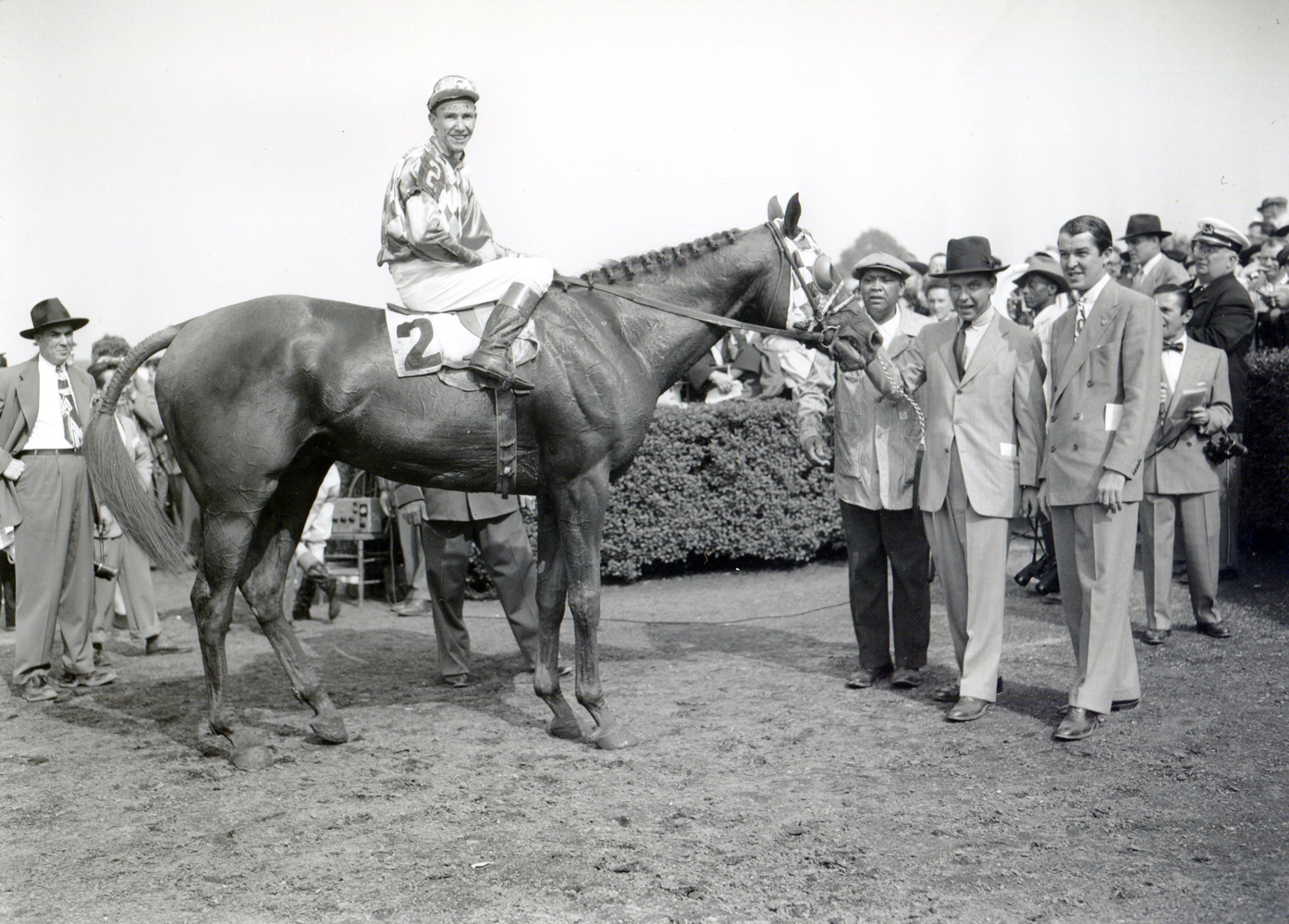 William C. Winfrey holds Loser Weeper (Nick Combest up) in the winner's circle for the 1950 Suburban Handicap at Belmont Park (Keeneland Library Morgan Collection/Museum Collection)