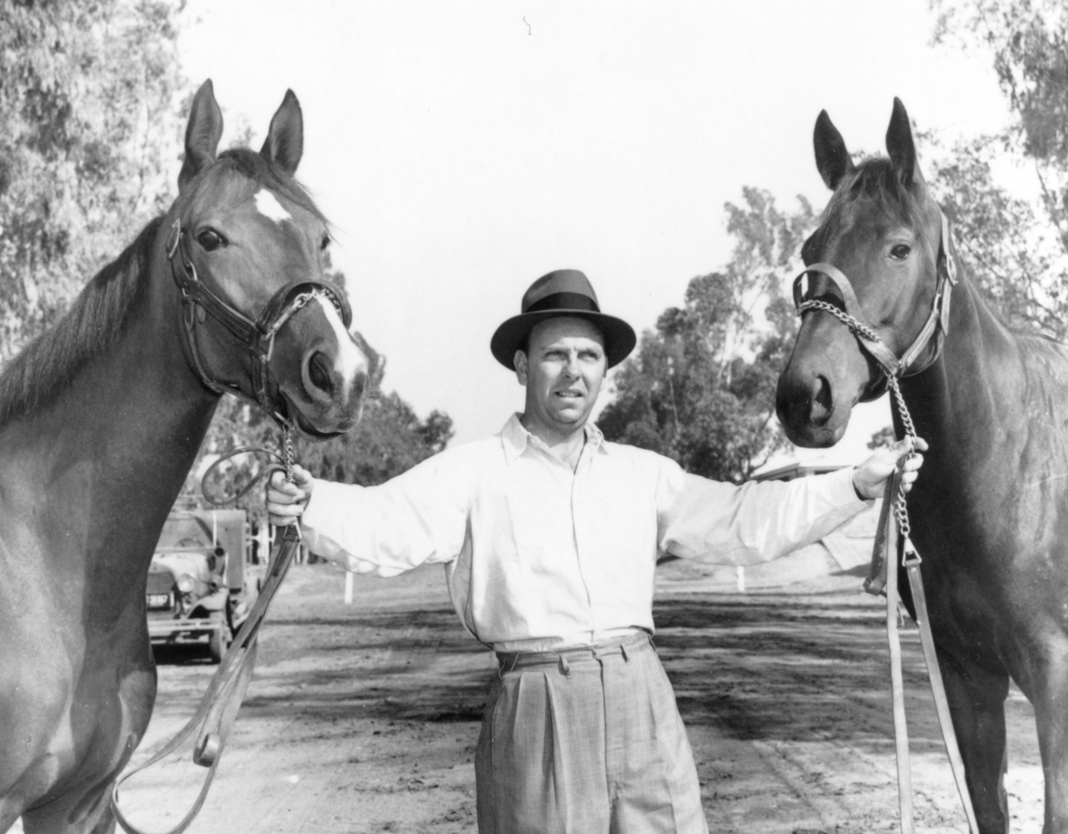 William C. Winfrey holding two unidentified horses in 1971 (Museum Collection)