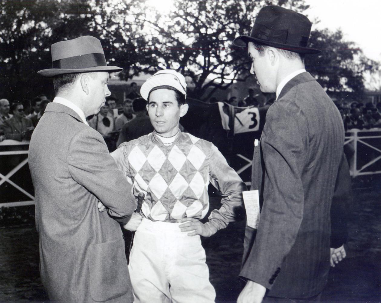 Trainer William C. Winfrey, jockey Eric Guerin, and owner Alfred G. Vanderbilt II in the Santa Anita paddock, circa 1952 (Bill Mochon/Museum Collection)