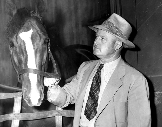 Ben Jones with Calumet Farm's Sun Again in the barn (Museum Collection)